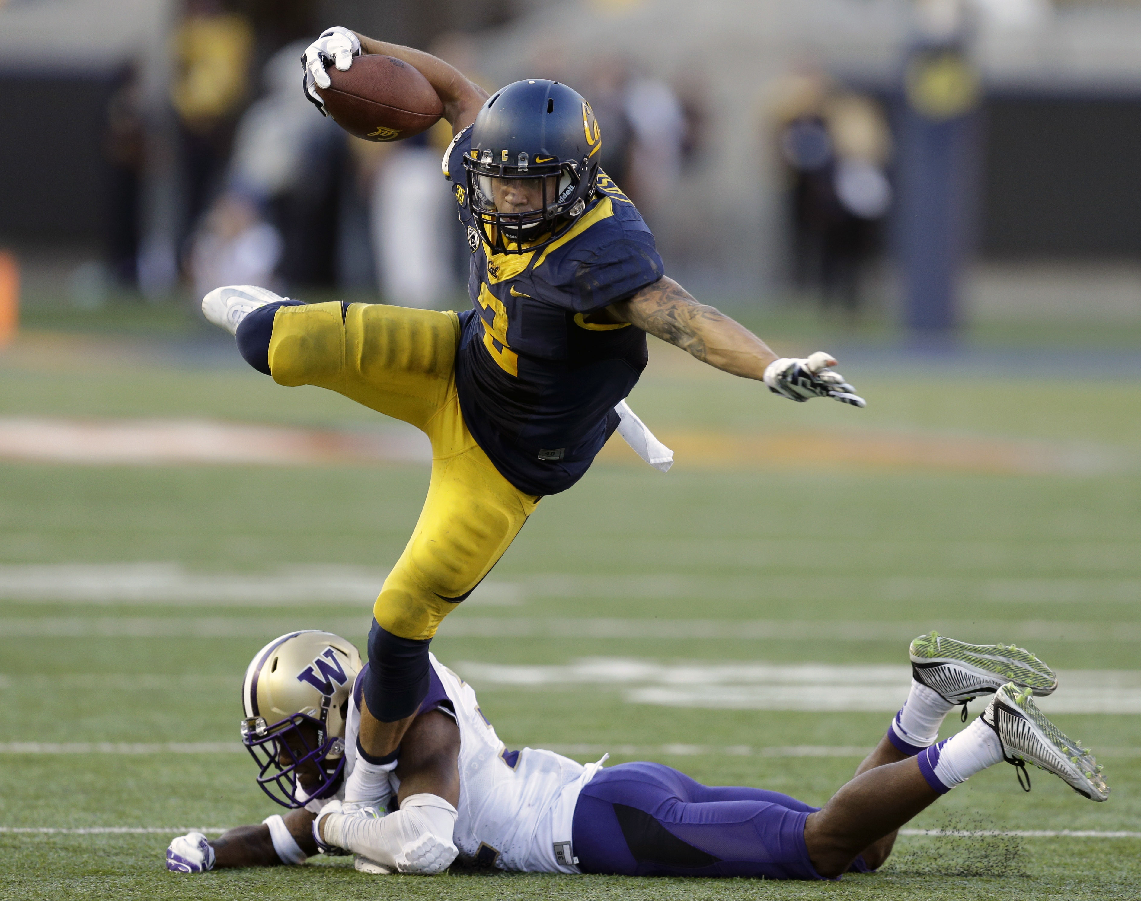 FILE -  In this Saturday, Oct. 11, 2014, file photo, California's Daniel Lasco (2) tries to evade the grasp of Washington's Budda Baker during the second half of an NCAA college football game in Berkeley, Calif. A potential first-round draft pick at quart