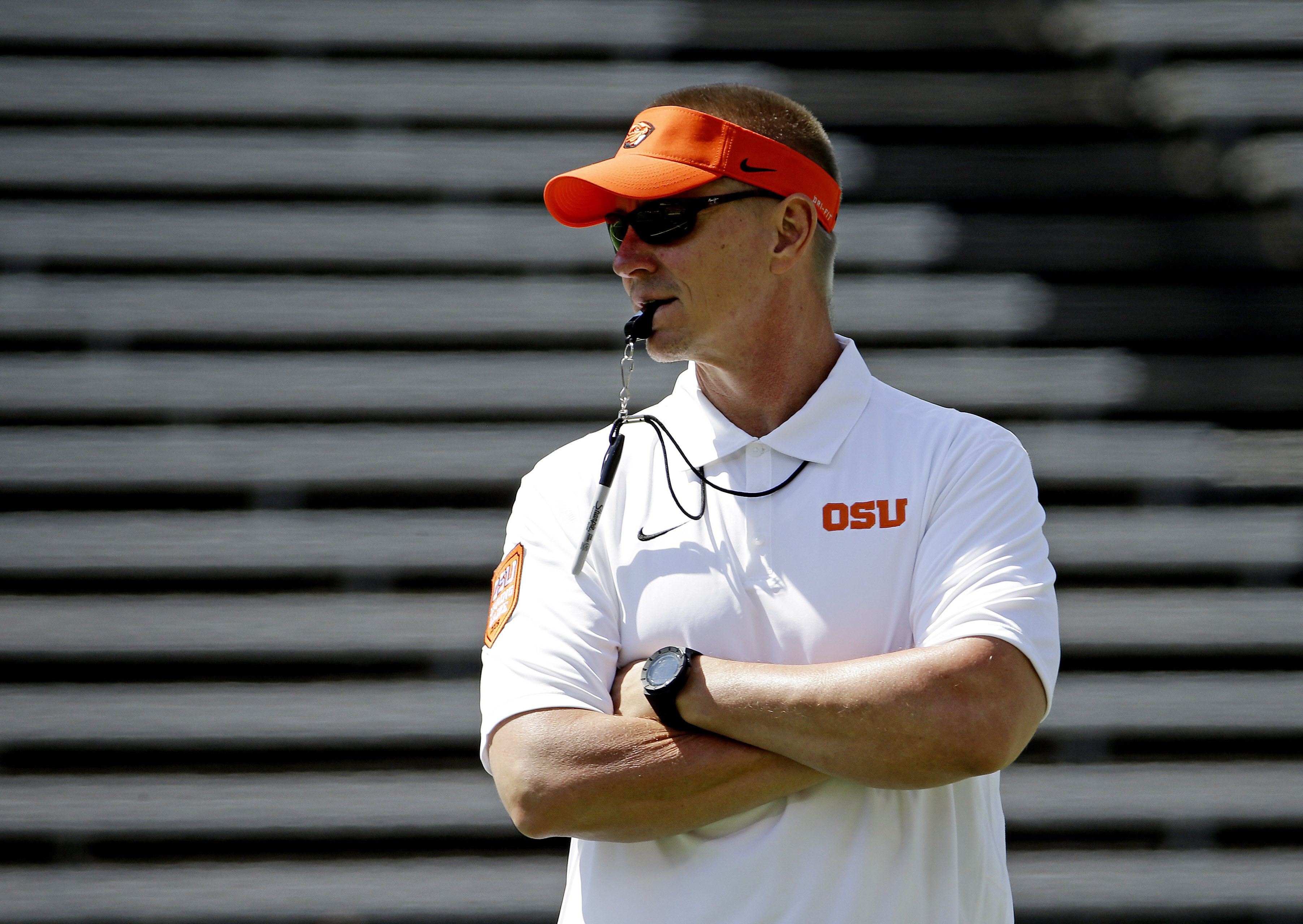 FILE - In this April 18, 2015, file photo, Oregon State football coach Gary Anderson watches during the first half of the NCAA college football team's spring game in Corvallis, Ore.  It is definitely a time of change for the Beavers with a new coach, a ne