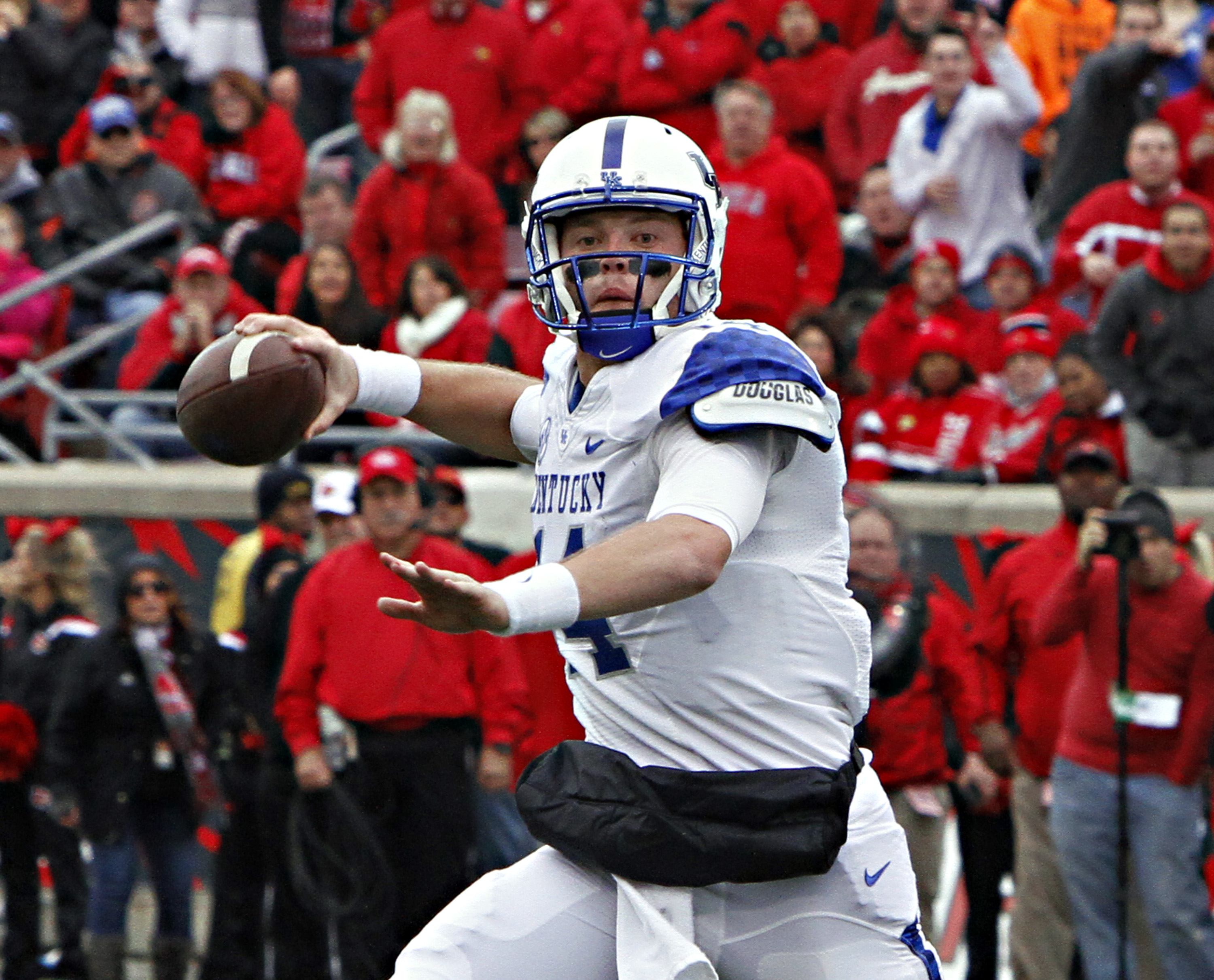 FILE - In this Nov. 29, 2014, file photo, Kentucky quarterback Patrick Towles looks to pass against rival Louisville in their NCAA college football game in Louisville, Ky. Coach Mark Stoops has named junior incumbent Patrick Towles as his starting quarter