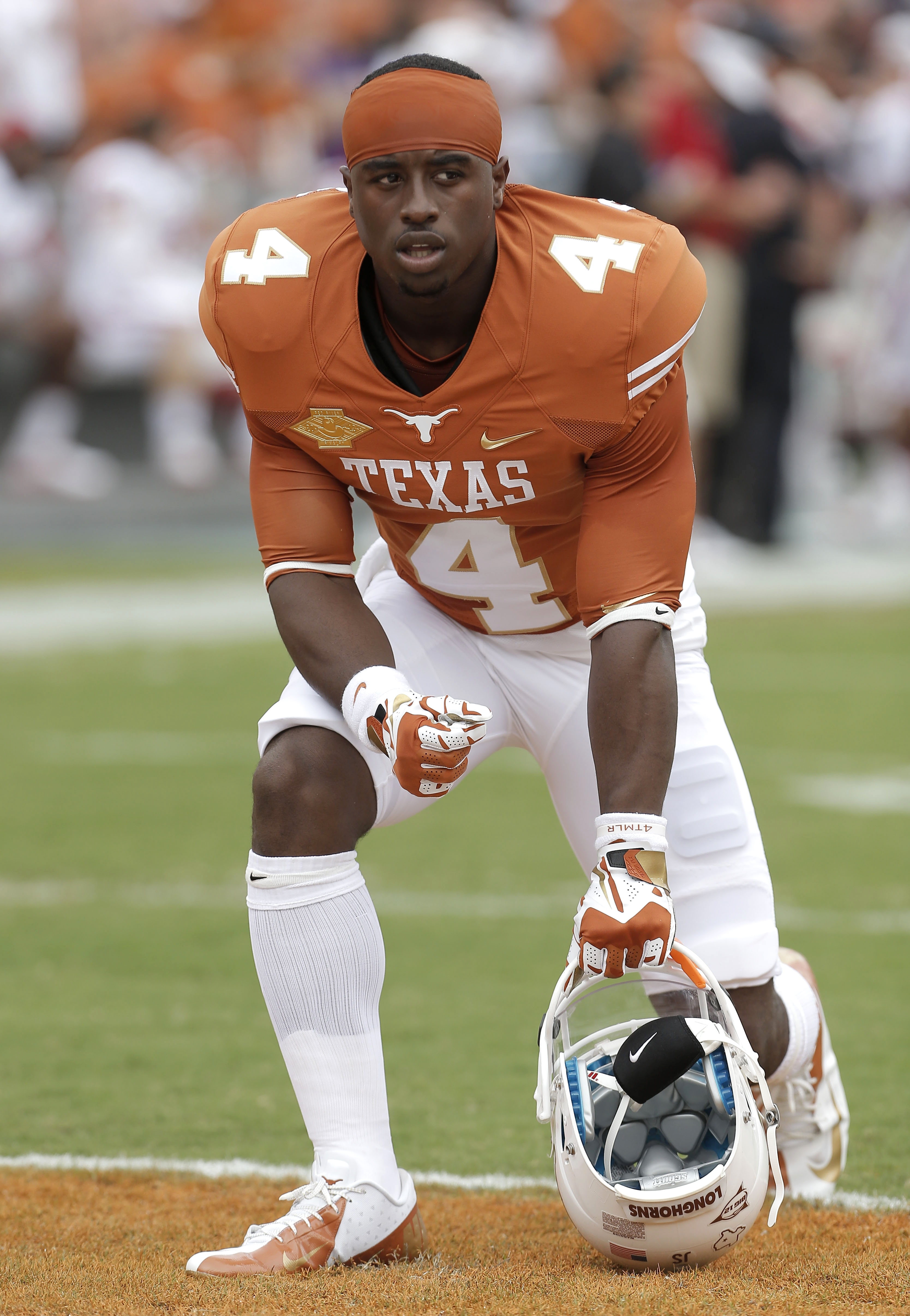 FILE-In this Oct. 12, 2013, file photo, Texas running back Daje Johnson (4) kneels on the field during the first half of an NCAA college football game at the Cotton Bowl in Dallas. For three years, Johnson has been the great hope and the great disappointm