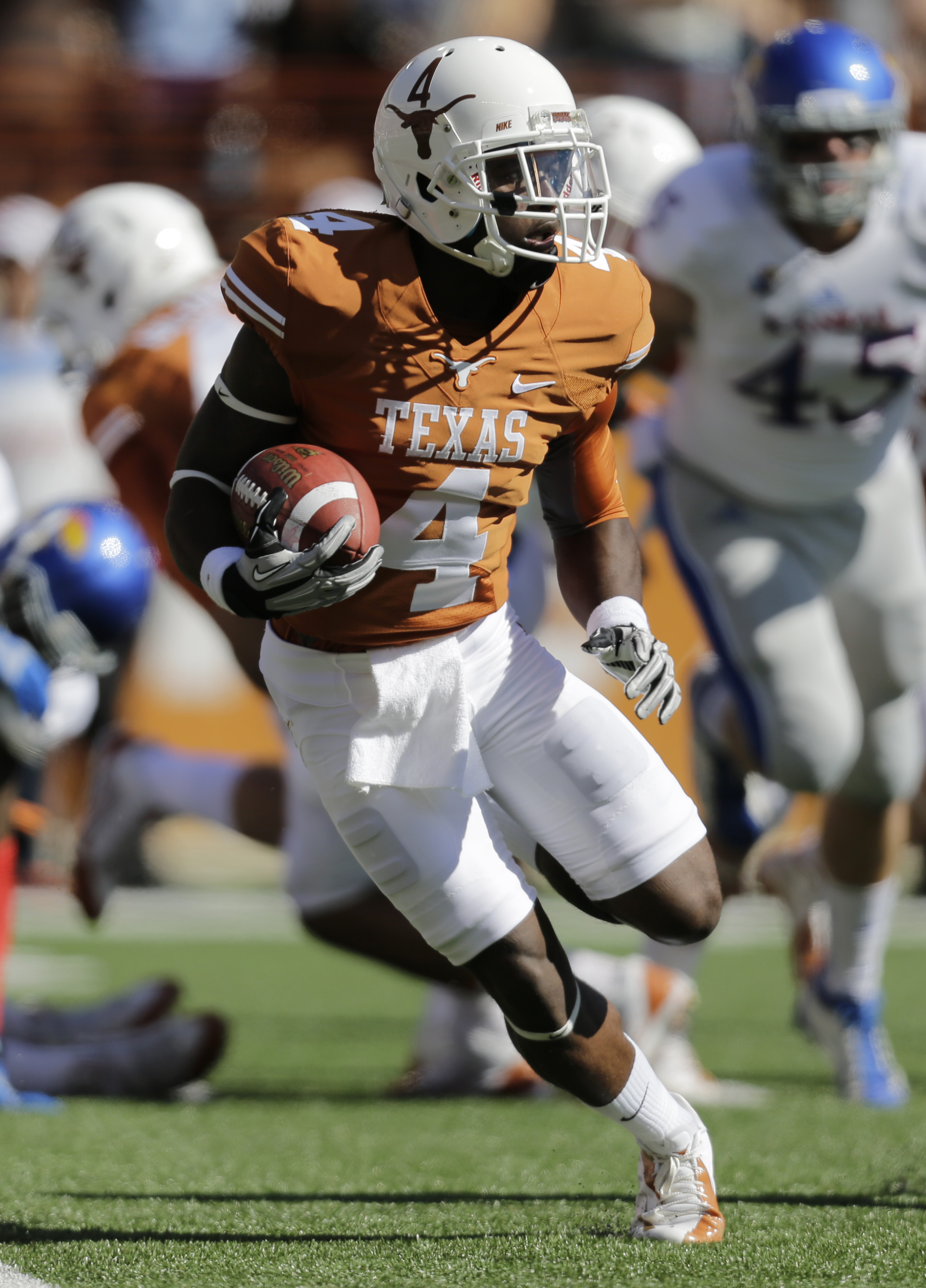 FILE-In this Nov. 2, 2013, file photo, Texas' Daje Johnson returns a kickoff during the first half of an NCAA college football game in Austin, Texas. For three years, Johnson has been the great hope and the great disappointment for Texas. The playmaker wi