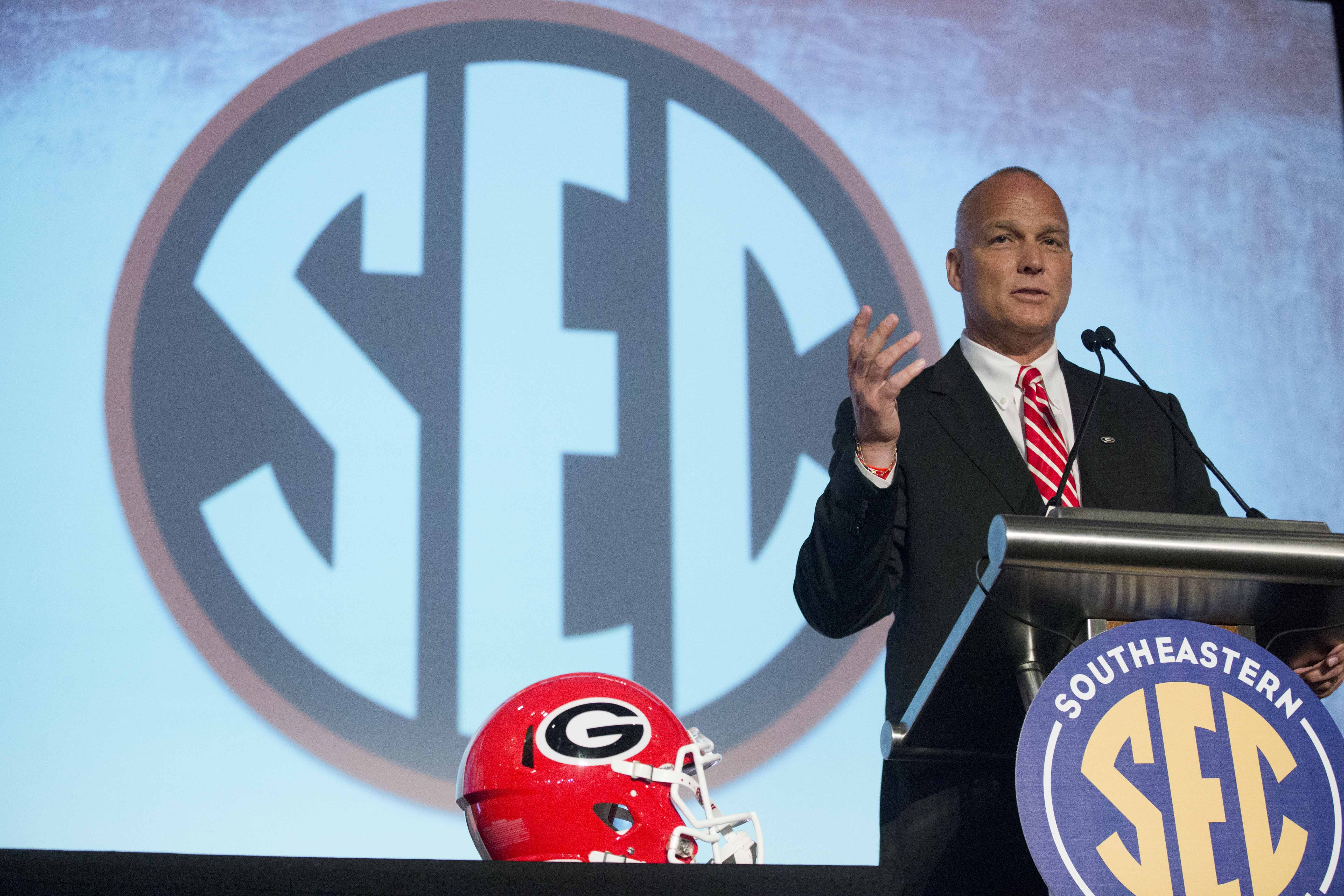 FILE - In this July 16, 2015, file photo, Georgia coach Mark Richt speaks to the media at the Southeastern Conference NCAA college football media days in Hoover, Ala. Richt must pick a new starting quarterback. Even with that big unknown, there is great a