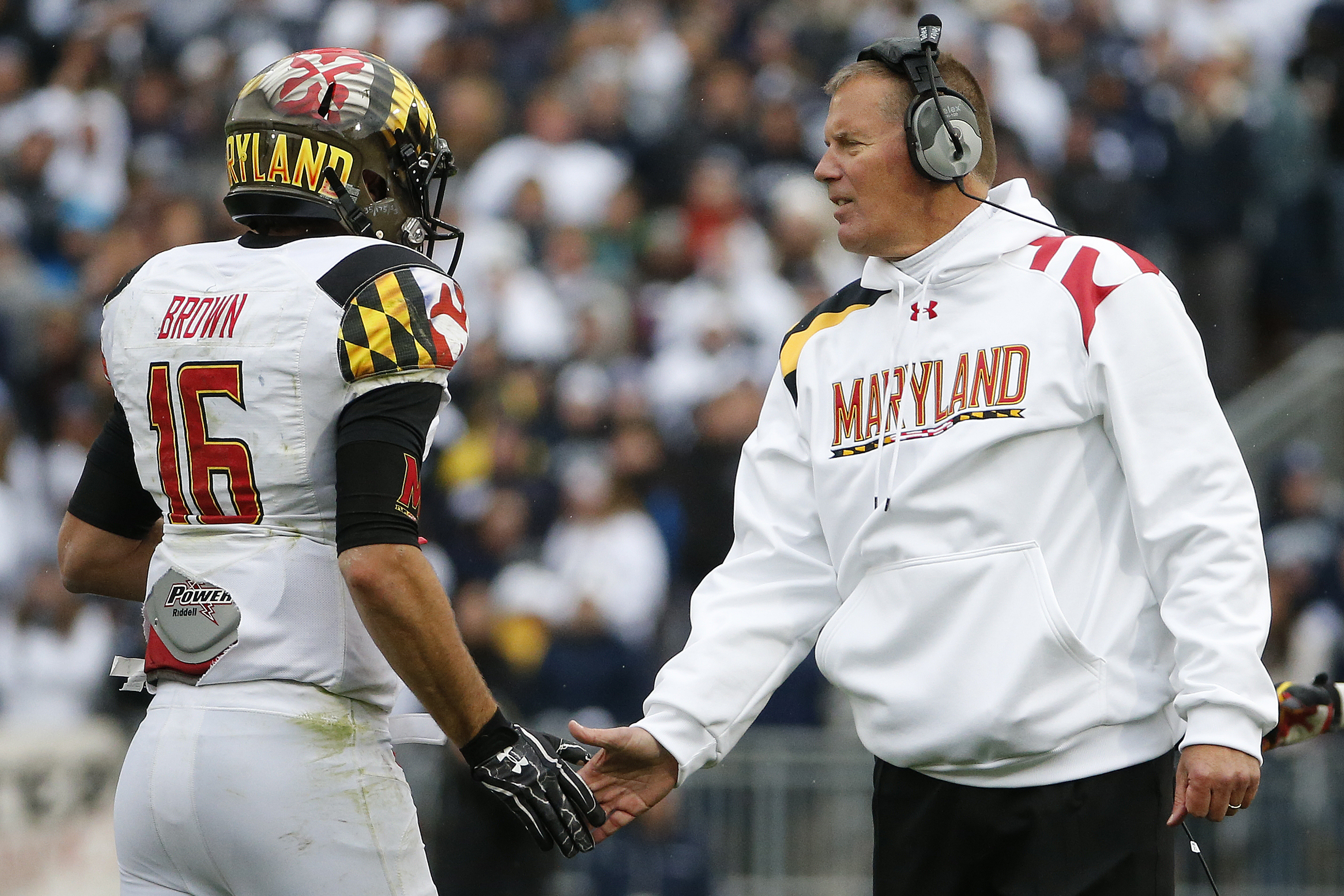FILE - In this Nov. 1, 2014 file photo, Maryland head coach Randy Edsall, right, greets quarterback C.J. Brown as he returns to the sideline after throwing a touchdown pass during an NCAA college football game against Penn State in State College, Pa. The