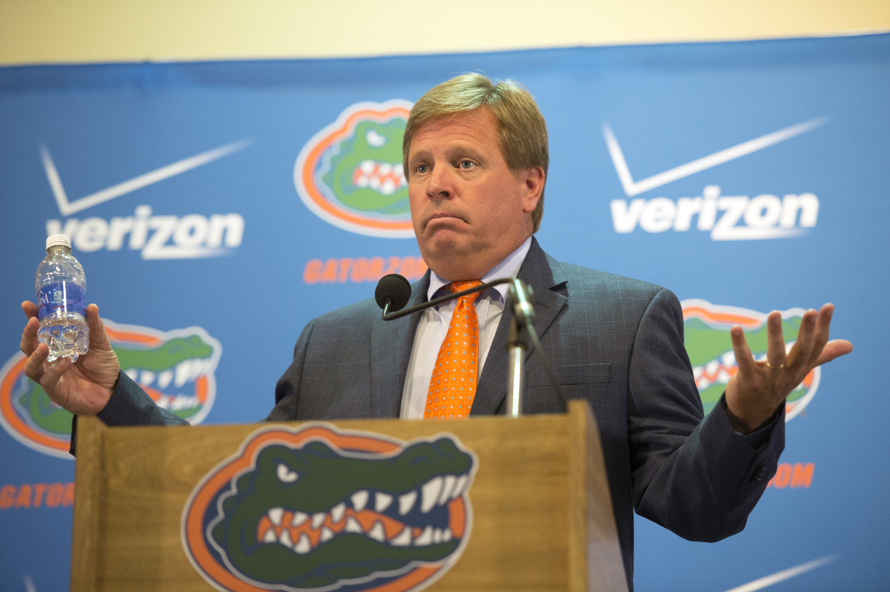 FILE - In this Aug. 5, 2015, file photo, Florida NCAA college football coach Jim McElwain speaks to the media during the teams media day in Gainesville, Fla. McElwain has offered few details about his revamped offense this fall, quite possibly because he