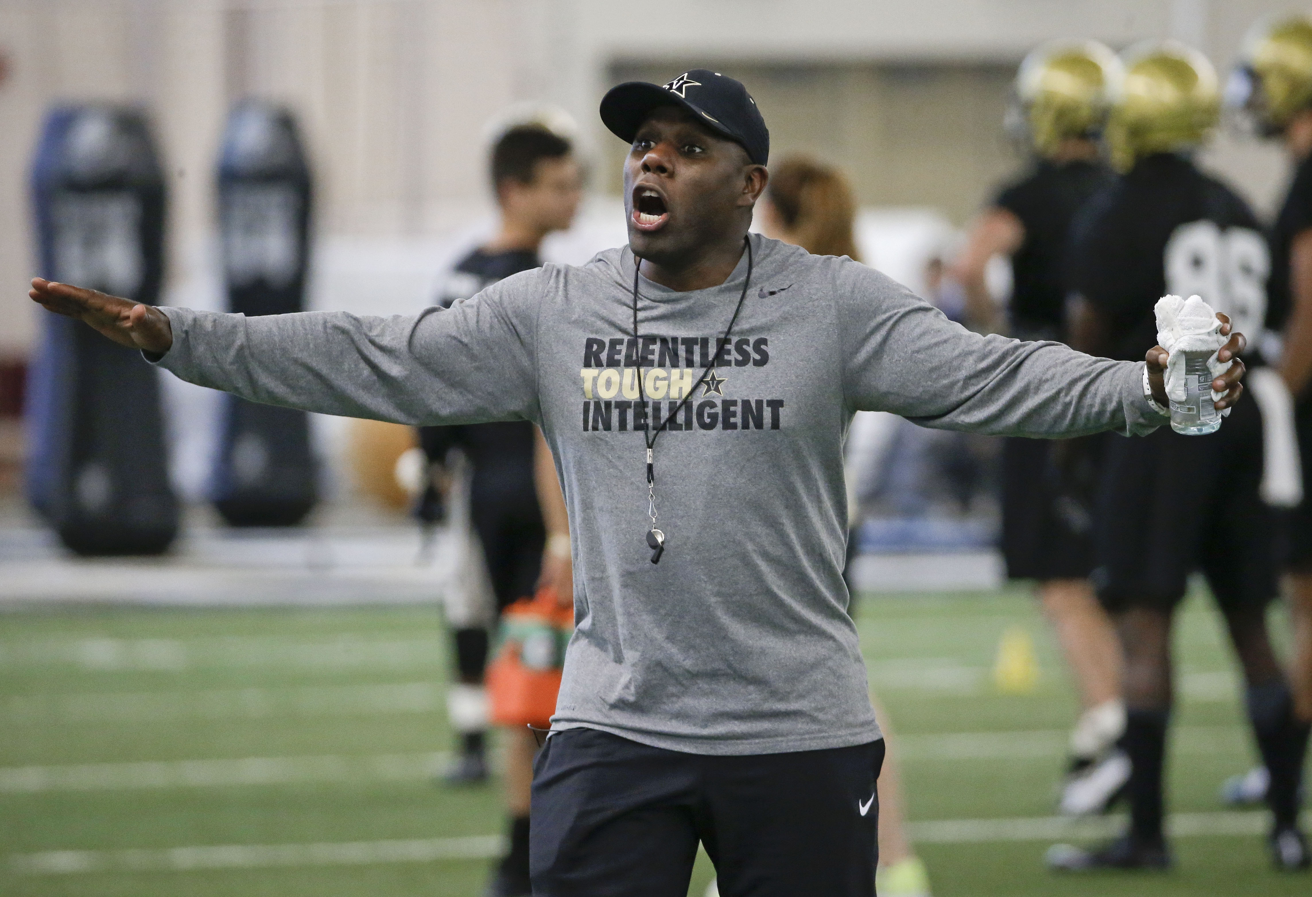 FILE -- In this Aug. 6, 2015, file photo, Vanderbilt head coach Derek Mason leads an NCAA college football practice in Nashville, Tenn. In his second season, Mason hopes to improve on last year's 3-9 record, failing to win even one game in the Southeaster