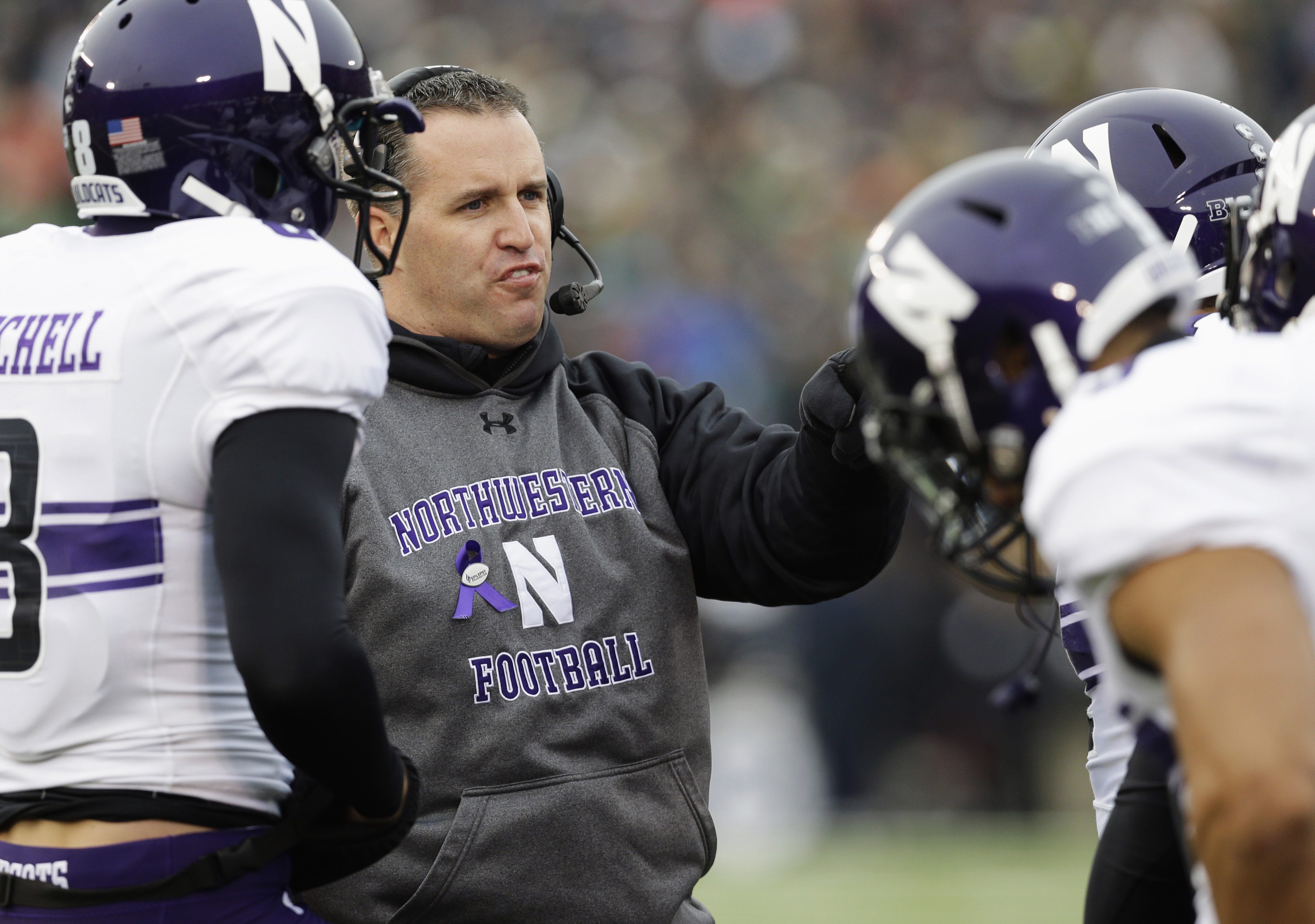 FILE - In this Nov. 15, 2014, file photo, Northwestern head coach Pat Fitzgerald talks to his team during an NCAA college football game against Notre Dame in South Bend. Fitzgerald is entering his 10th season leading his alma mater.  Northwestern hosts St