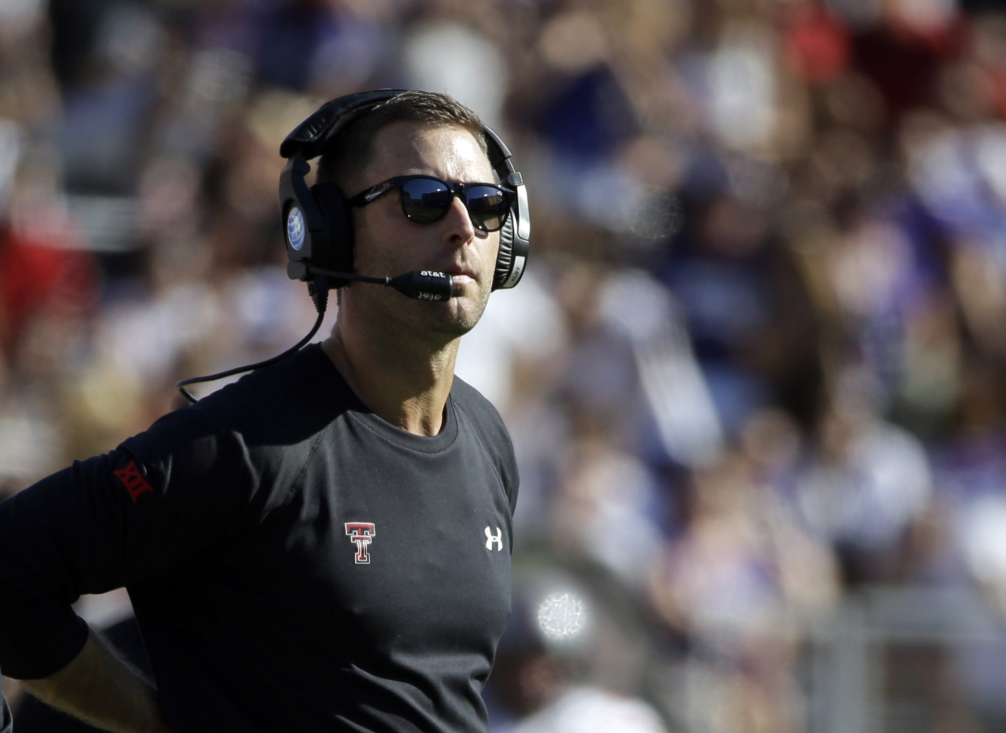 """FILE - In this Oct. 25, 2014, file photo, Texas Tech head coach Kliff Kingsbury watches play in the first half of an NCAA college football game against TCU in Fort Worth, Texas. Kingsbury calls his options at quarterback this season a """"luxury."""" Sophomore"""