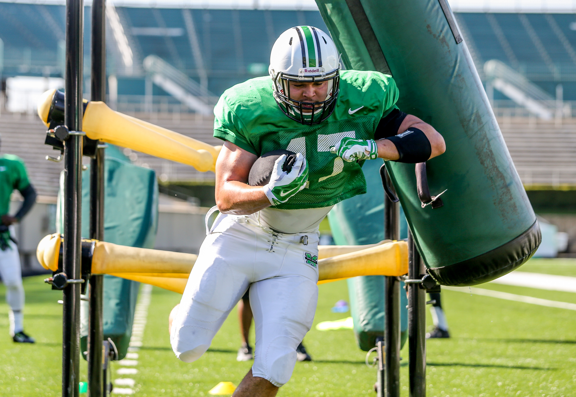 FILE - In this April 18, 2015, file photo, Marshall running back Devon Johnson runs through a drill as the NCAA college football team held an intrasquad scrimmage in Huntington, W.Va. Nicknamed Rockhead for his bruising style, the 244-pound Johnson's move