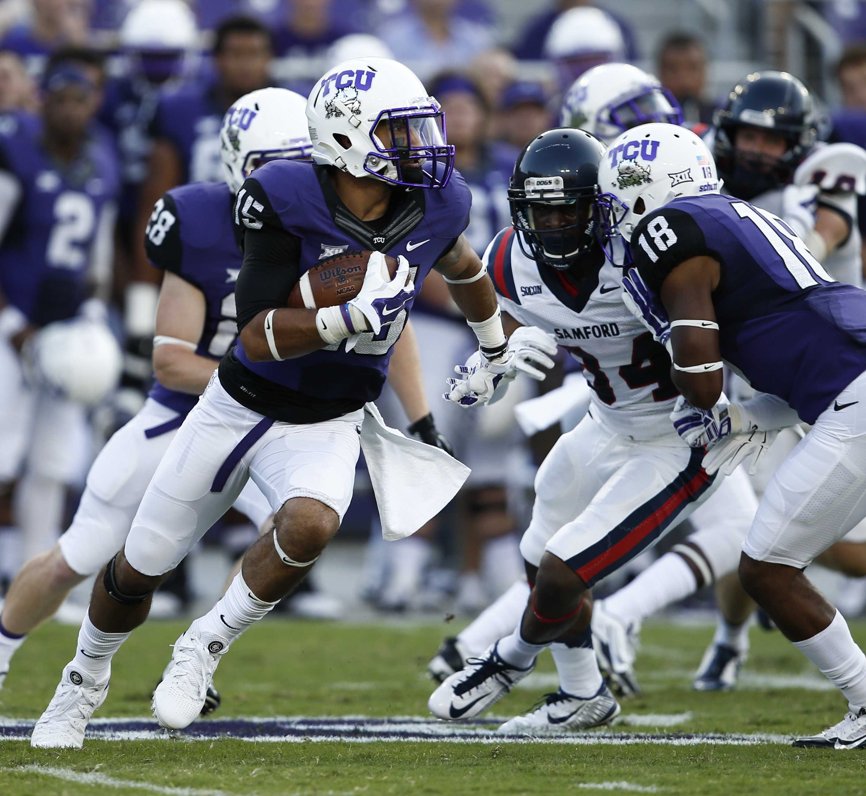 TCU wide receiver Cameron Echols-Luper (15) runs past \s9in the first half of an NCAA college football game in Fort Worth, Texas, Saturday, Aug. 30, 2014. (AP Photo/Jim Cowsert)