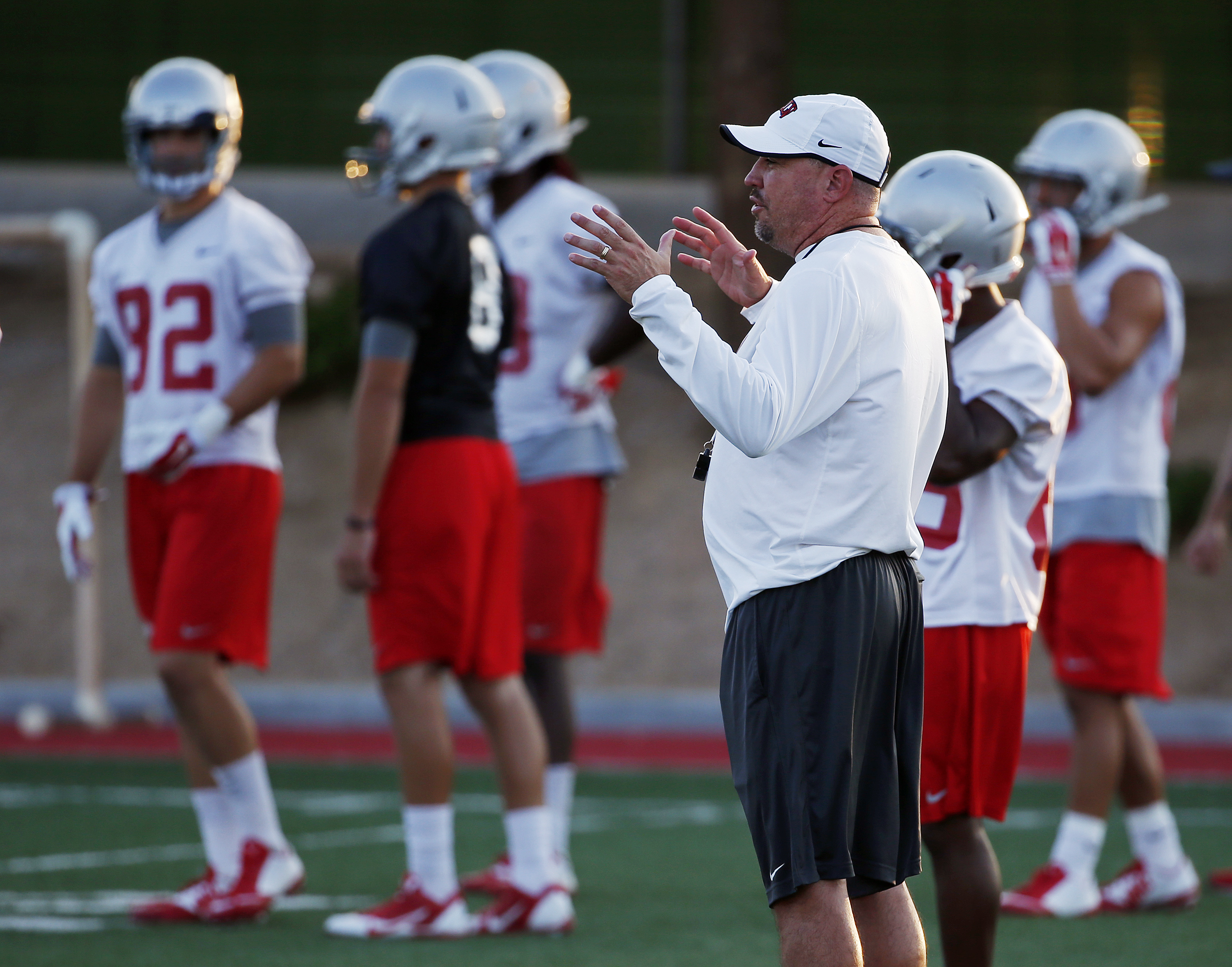 In this Aug. 20, 2015, photo, UNLV head football coach Tony Sanchez speaks during practice in Las Vegas. Sanchez has made the rare jump directly from coaching high school to a head coach position at a college program. (AP Photo/John Locher)