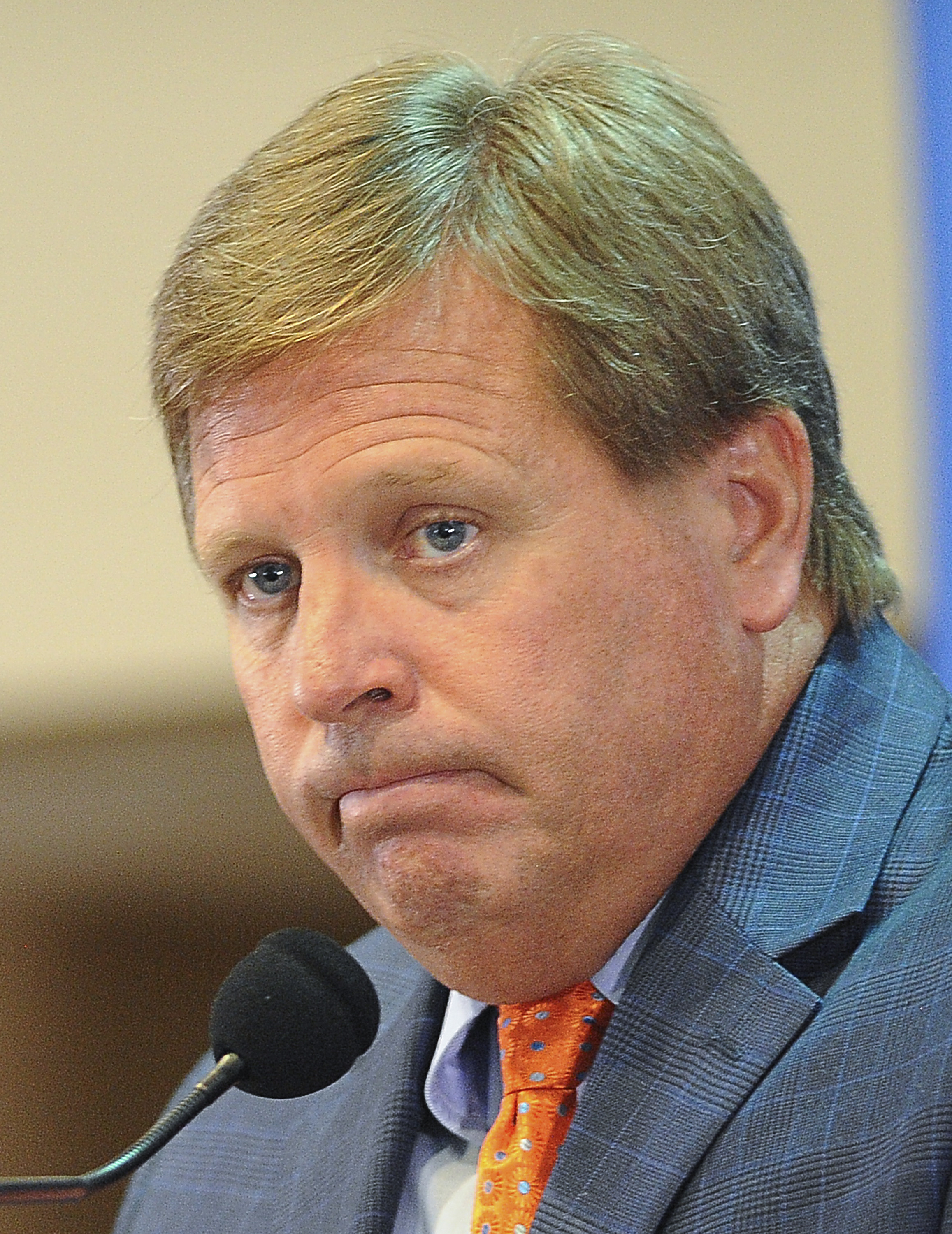 FILE - In this Aug. 5, 2015, file photo, Florida coach Jim McElwain listens to a question from the media during the university's NCAA college football media day in Gainesville, Fla. McElwain won't tolerate silly penalties, especially those for unsportsman