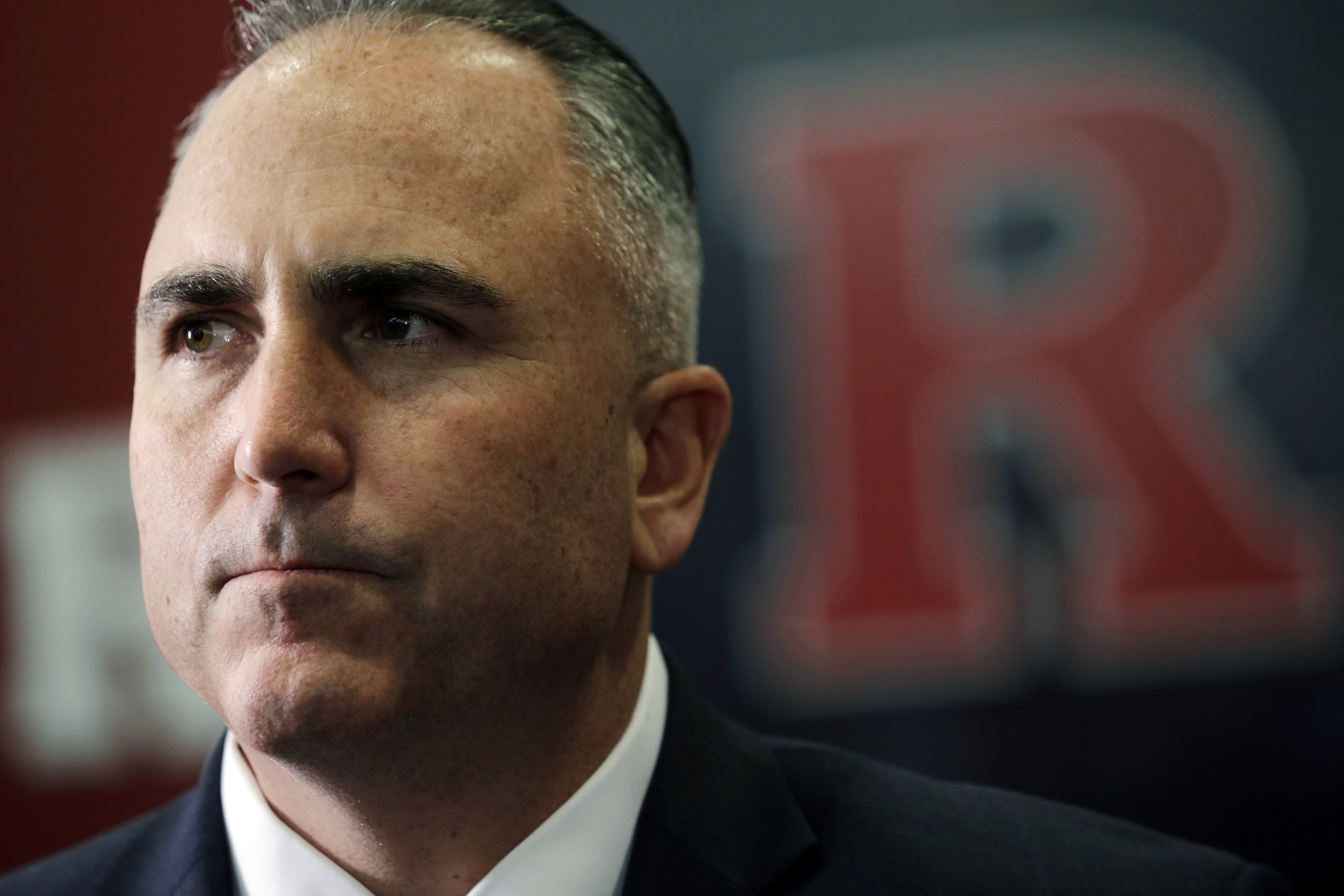 FILE - This is a Feb. 4, 2015, file photo showing Rutgers football head coach Kyle Flood listening to a question about the Scarlet Knights' recruiting class on national signing day in Piscataway, N.J. Rutgers is investigating whether football coach Kyle F