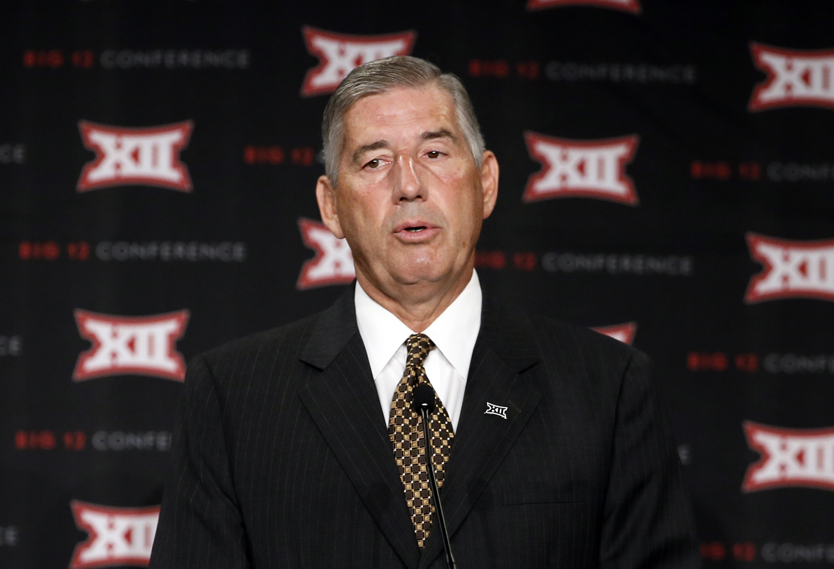 FILE - This July 20, 2015, file photo shows Big 12 commissioner Bob Bowlsby addressing attendees to Big 12 Conference Football Media Days  in Dallas. Bowlsby says he expects the conference to mandate due diligence and include more than just violent acts i