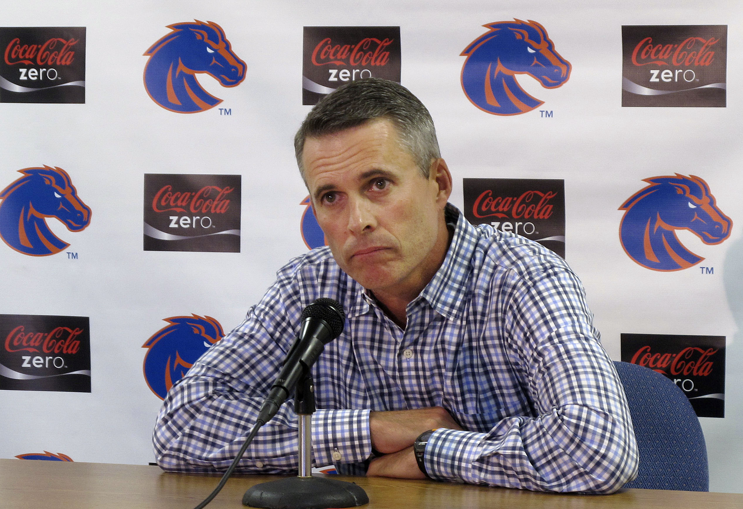 ADVANCE FOR WEEKEND EDITIONS, AUG. 29-30 - FILE - In this Sept. 9, 2013, file photo, then-Boise State head coach Chris Petersen speaks at a news conference in Boise, Idaho. What Petersen accomplished in his 13 years at Boise State was raising the profile