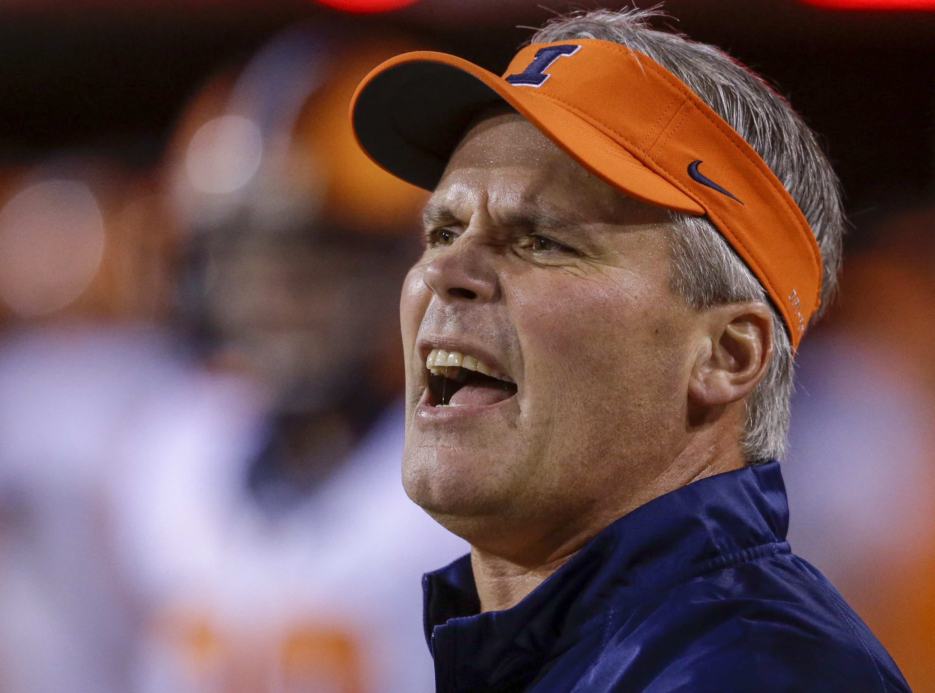 FILE - In this Sept. 27, 2014, file photo, Illinois head coach Tim Beckman calls instructions before an NCAA college football game against Nebraska in Lincoln, Neb. Illinois fired coach Tim Beckman one week before the start of the season Friday, Aug. 29,