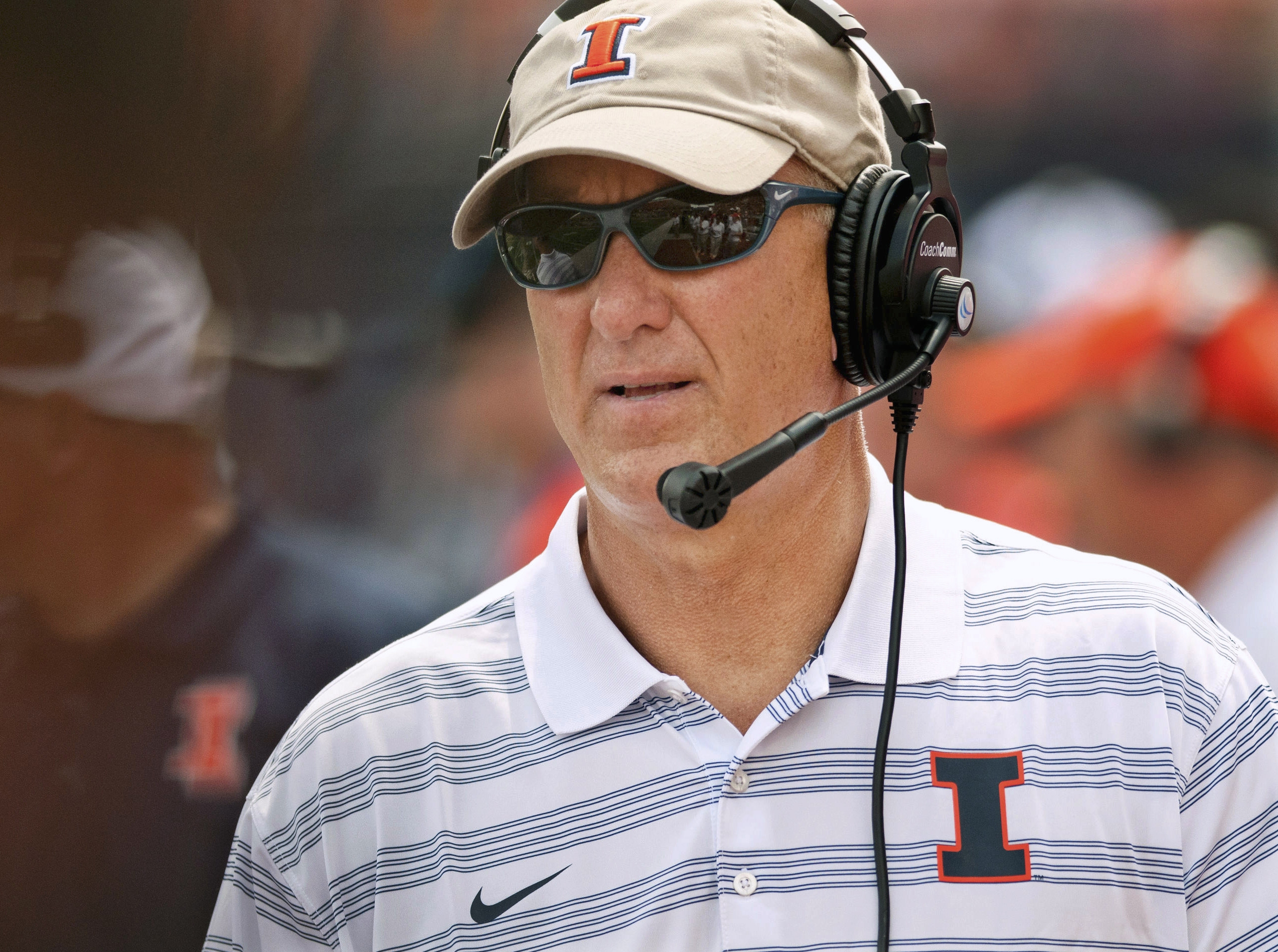 FILE - In this Aug. 30, 2014, file photo, Illinois offensive coordinator Bill Cubit watches from the sideline during an NCAA college football game against Youngstown State in Champaign, Ill. Cubit has been named interim coach as Illinois abruptly fired he