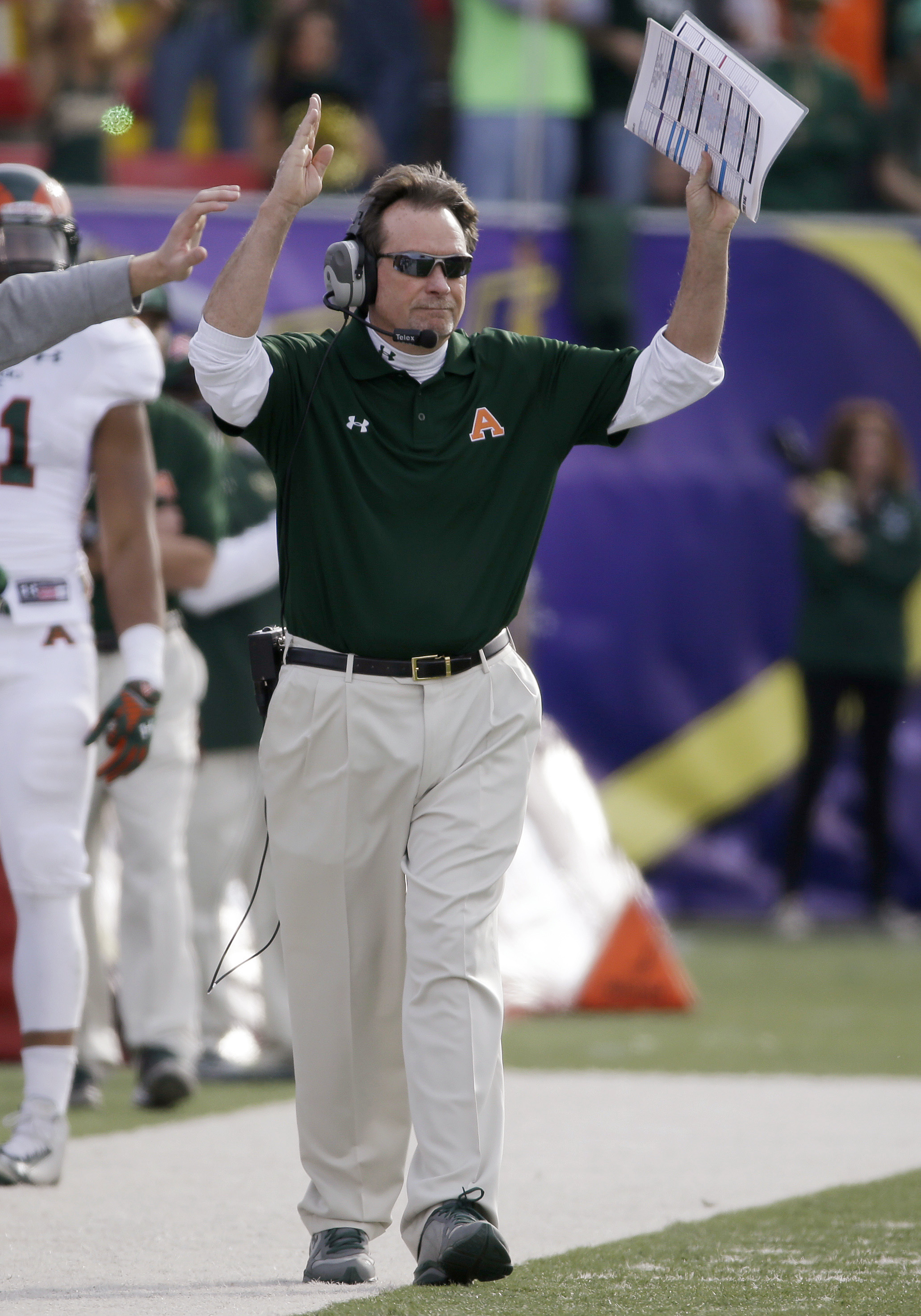 FILE - In this Dec. 20, 2014, file photo, Colorado State interim coach Dave Baldwin celebrates after his team scored a field goal against Utah during the Las Vegas Bowl NCAA college football game in Las Vegas. Now offensive coordinator at Oregon State, Ba