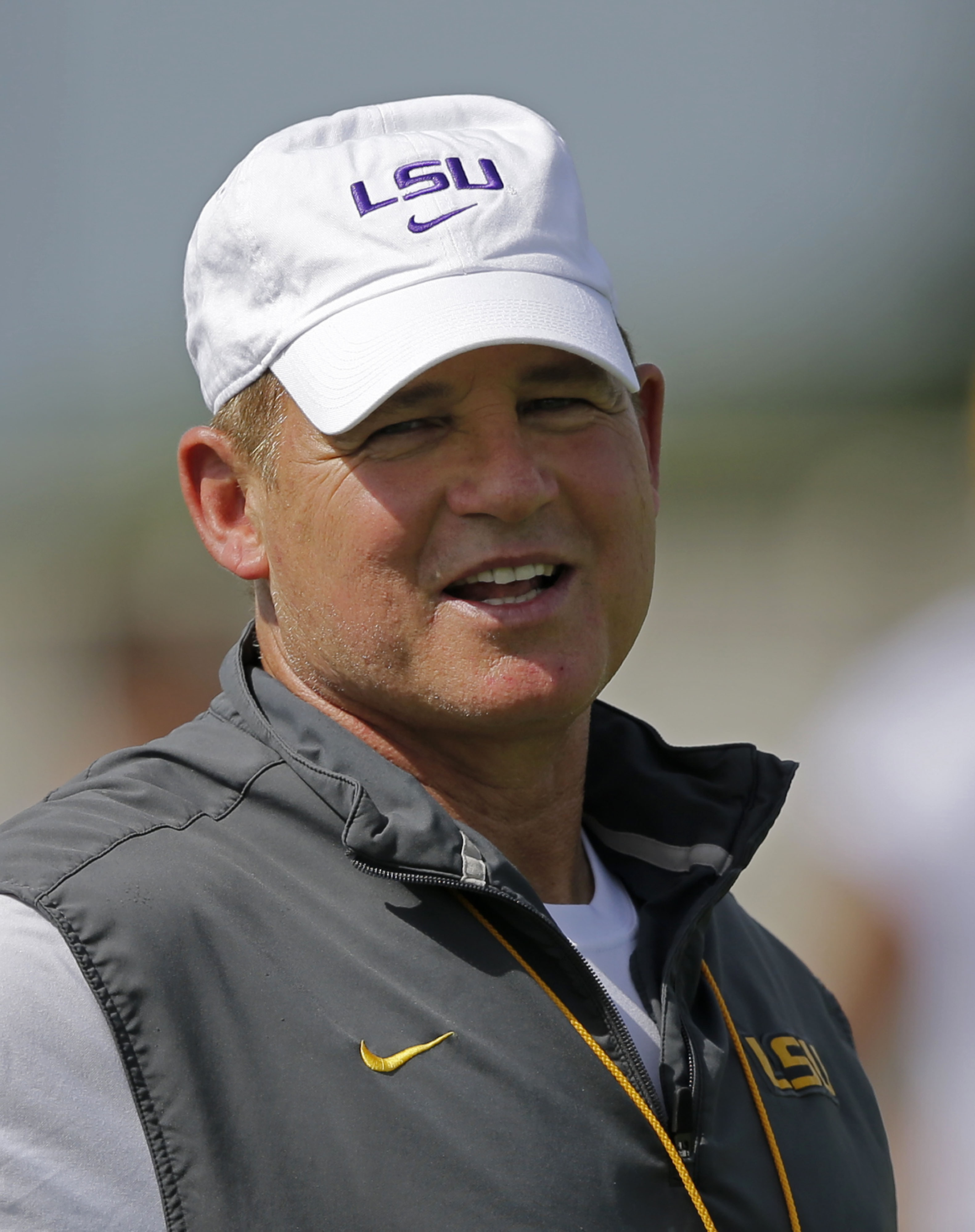 LSU head coach Les Miles watches during their NCAA college football practice in Baton Rouge, La., Friday, Aug. 7, 2015. (AP Photo/Gerald Herbert)