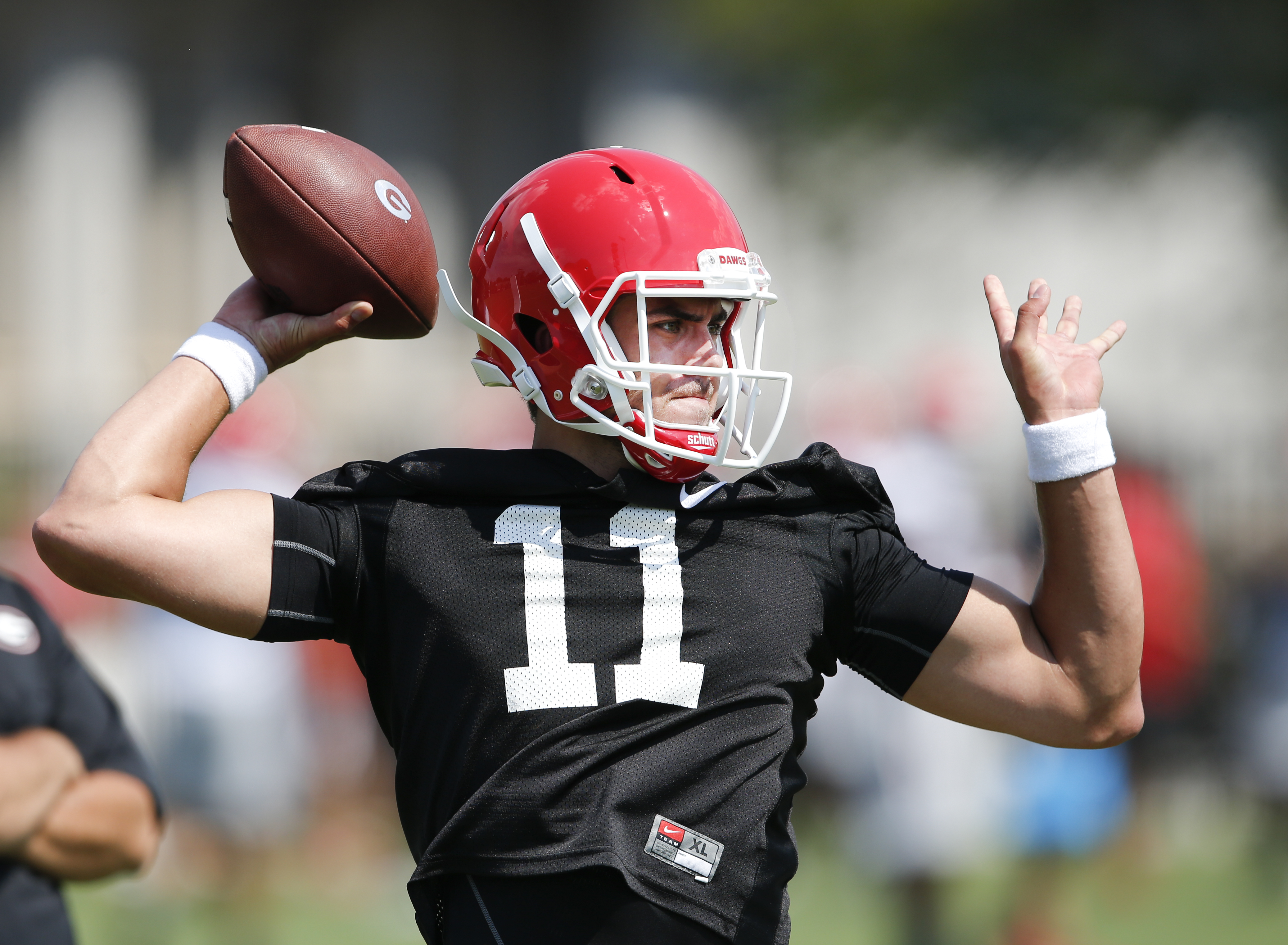 FILE - In this Aug. 4, 2015, file photo, Georgia quarterback Greyson Lambert works during a college football practice in Athens, Ga. Lambert is competing for the starting job. (AP Photo/John Bazemore, File)