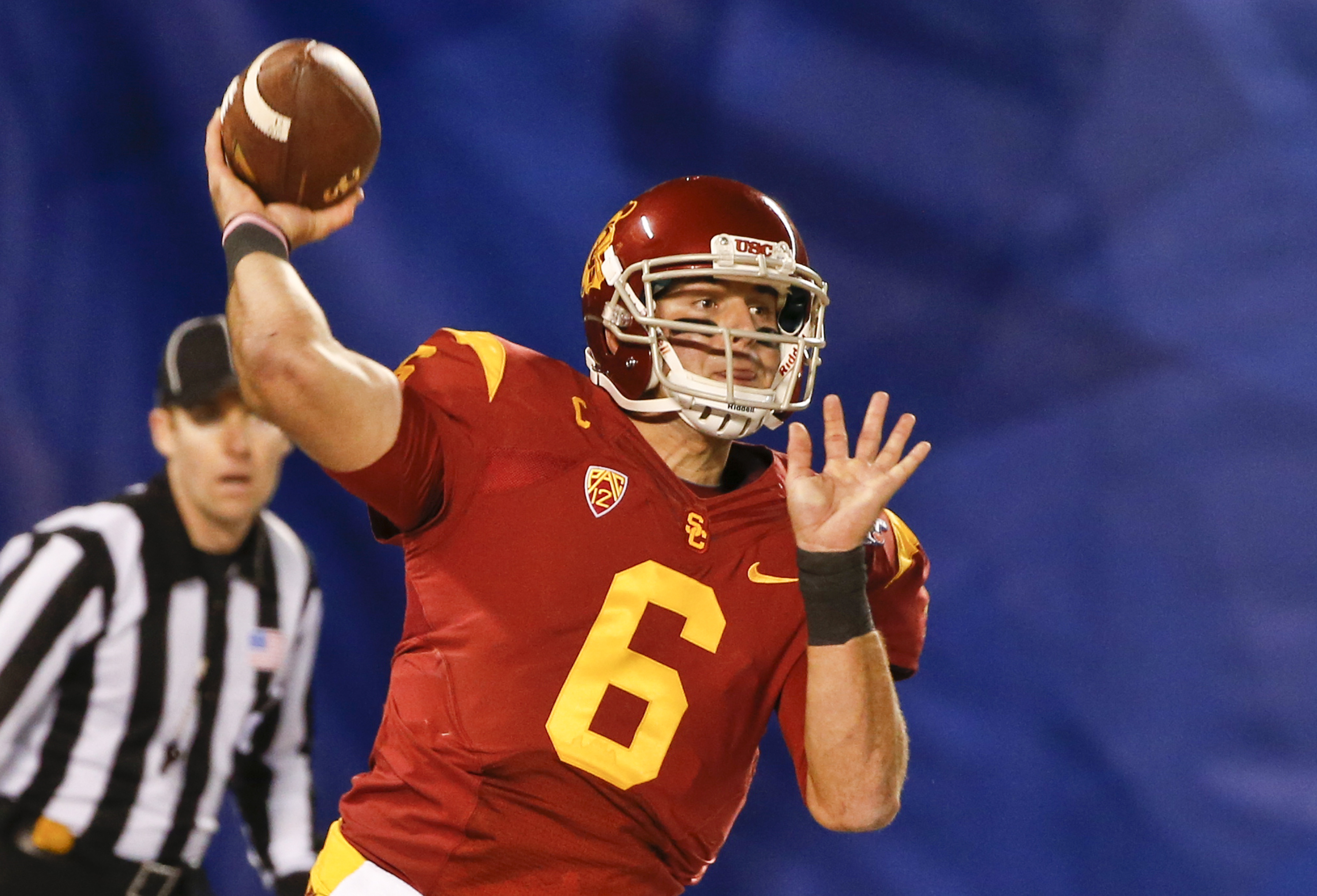 FILE - In this Dec. 27, 2014, file photo, Southern California quarterback Cody Kessler throws a pass against Nebraska during the first half of the Holiday Bowl NCAA college football game in San Diego. Kessler has already made it through almost every conce