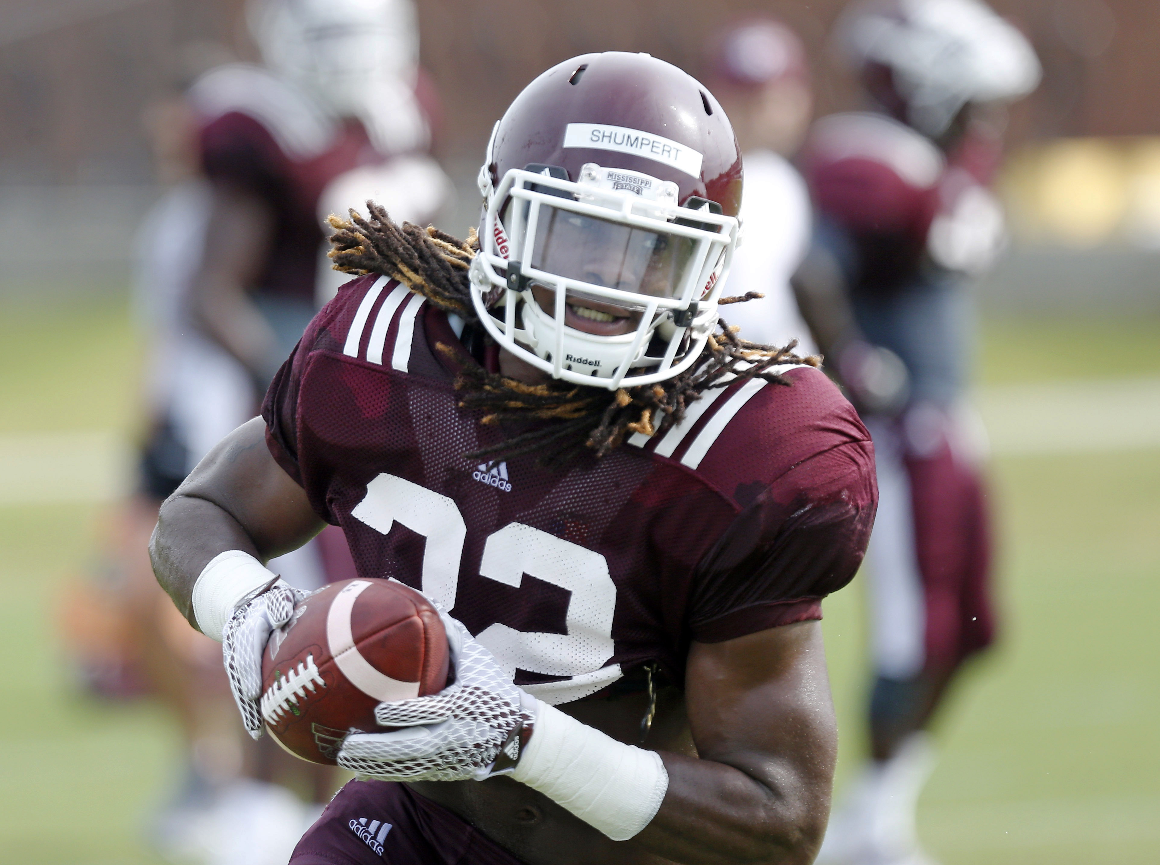 FILE - In this Aug. 7, 2015, file photo, Mississippi State running back Ashton Shumpert (32) runs during an NCAA college football practice in Starkville, Miss. (AP Photo/Rogelio V. Solis, File)