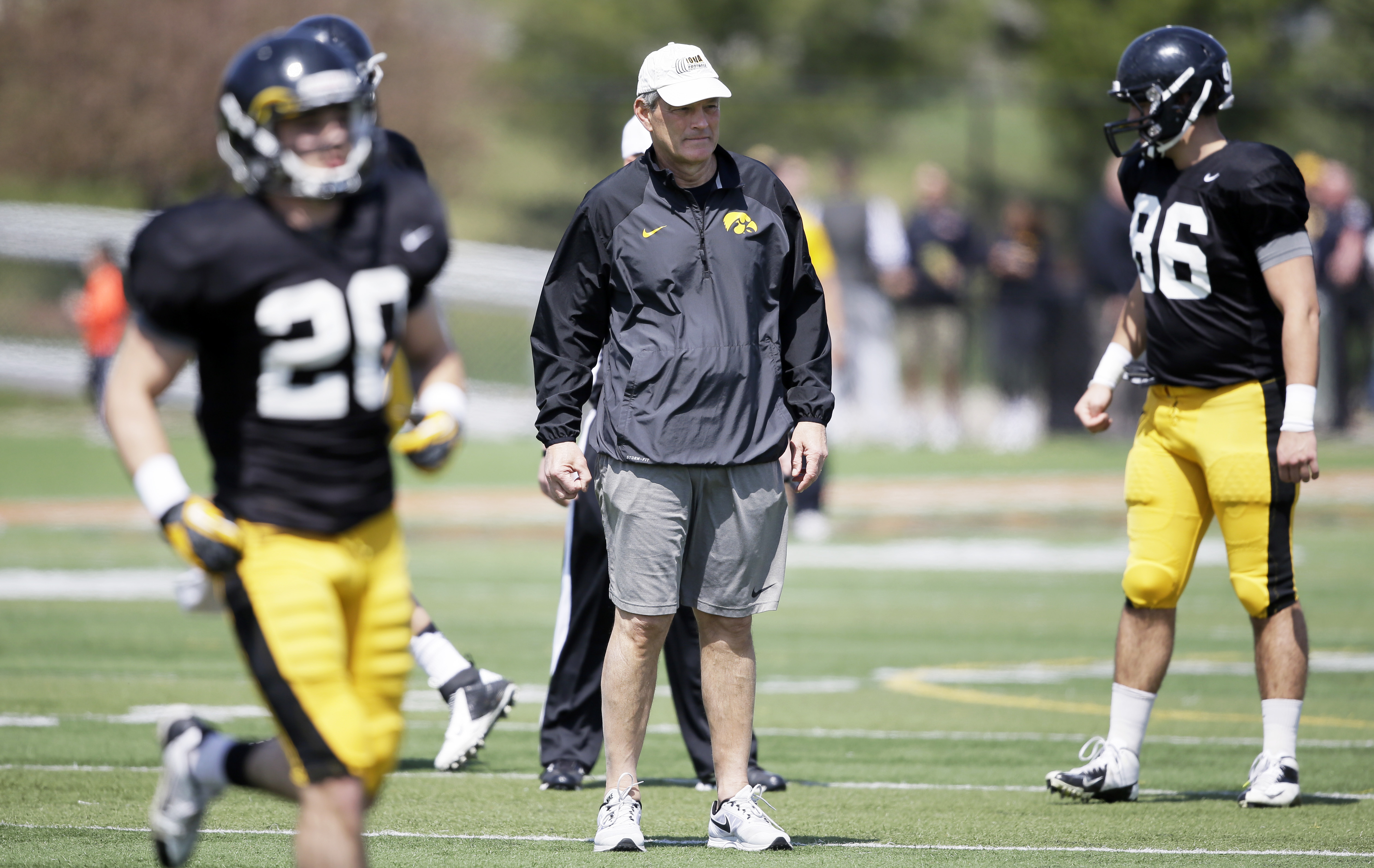 FILE - In this April 11, 2015, file photo, Iowa coach Kirk Ferentz watches his team during NCAA college football practice in West Des Moines, Iowa. Ferentz has made a ton of changes this offseason, from introducing alternate uniforms to switching practice