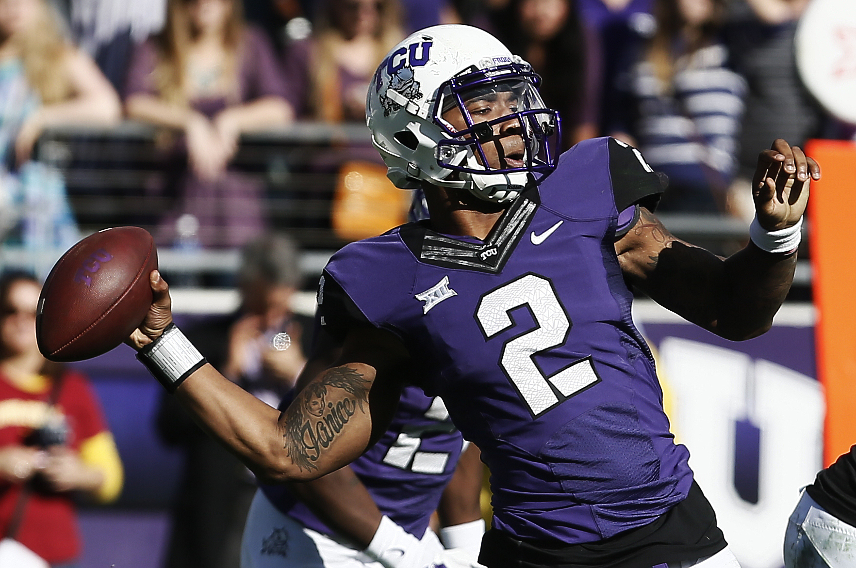 TCU quarterback Trevone Boykin (2) throws to a open receiver during the second half of an NCAA college football game against Iowa State at Amon G. Carter Stadium, Saturday, Dec. 6, 2014, in Fort Worth, Texas. TCU won 55-3. (AP Photo/Brandon Wade)