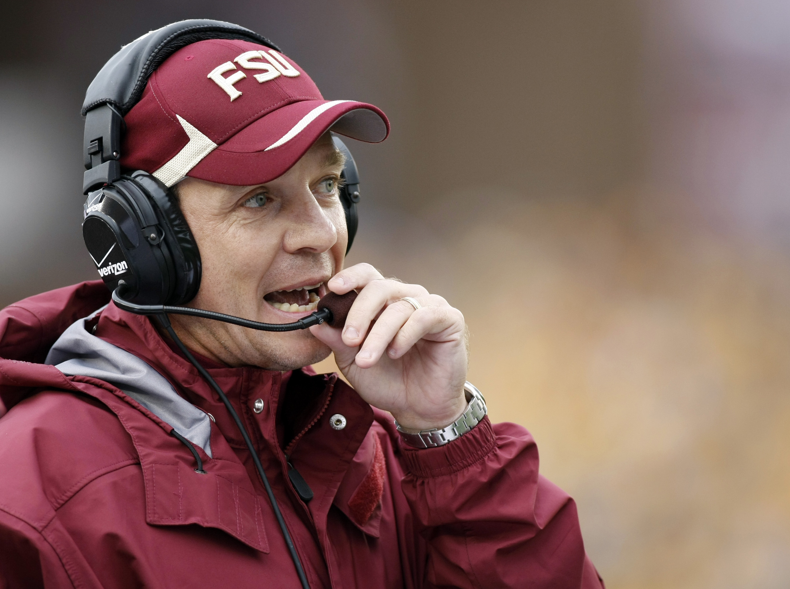 This Oct. 3, 2009 file photo shows Florida State offensive coordinator Jimbo Fisher making a call during the first half of an NCAA college football game against Boston College at Alumni Stadium in Boston. A lot of the attention on Florida State's offense