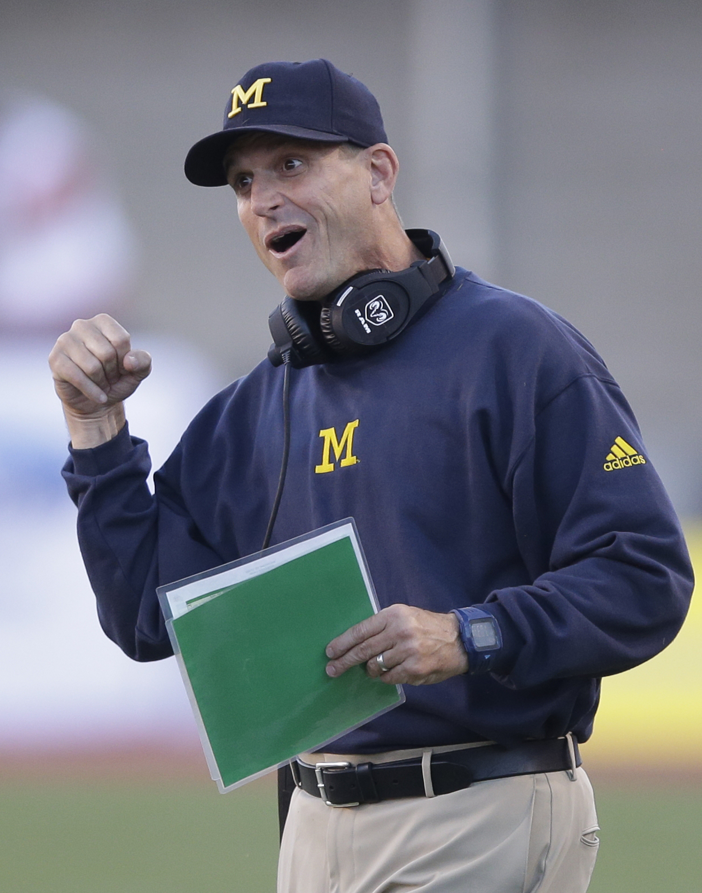 Michigan head coach Jim Harbaugh shouts to his team during the first quarter during an  NCAA college football game against Utah, Thursday, Sept. 3, 2015, in Salt Lake City. (AP Photo/Rick Bowmer)