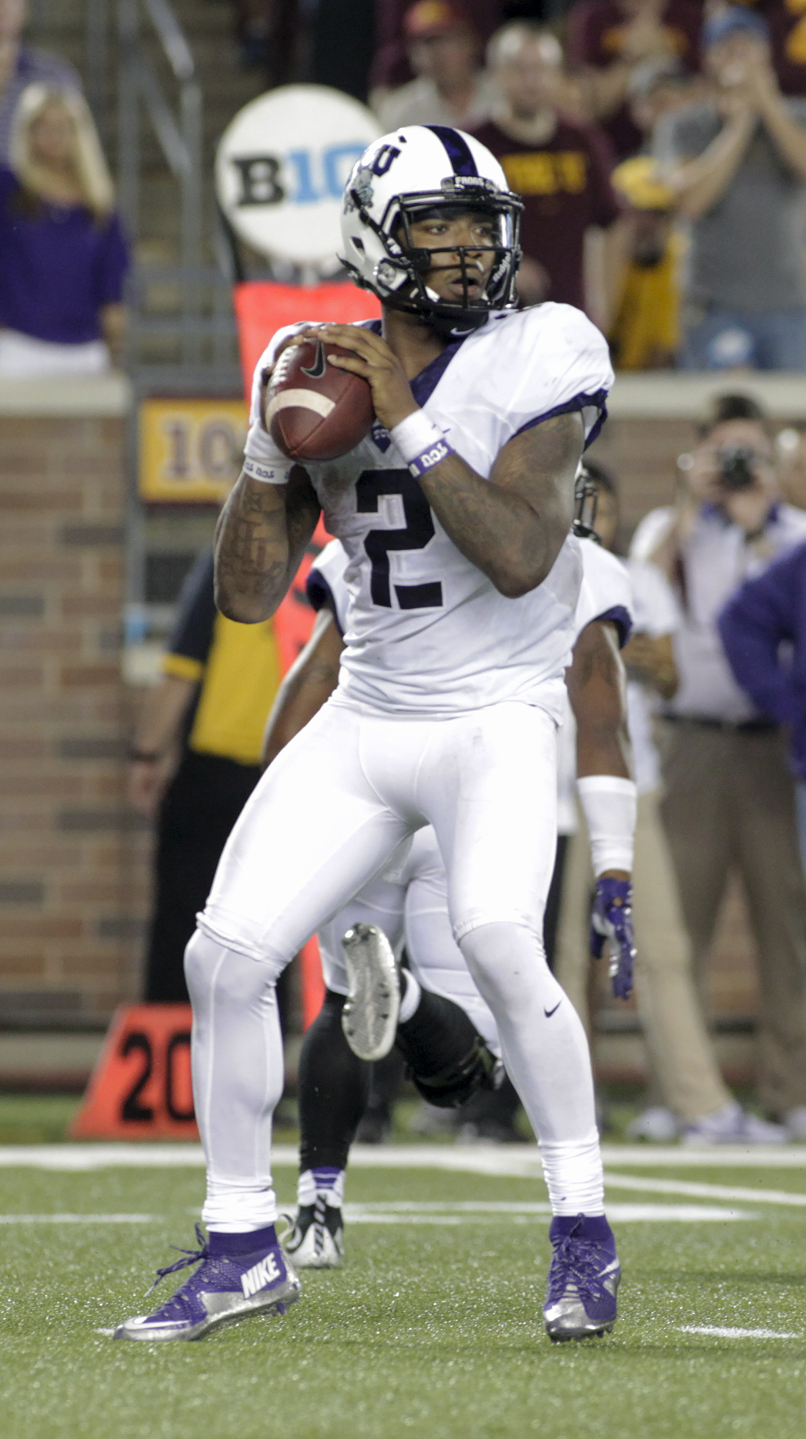 TCU quarterback Trevone Boykin (2) looks to pass during the first half of an NCAA college football game against Minnesota on Thursday, Sept. 3, 2015, in Minneapolis. (AP Photo/Paul Battaglia)