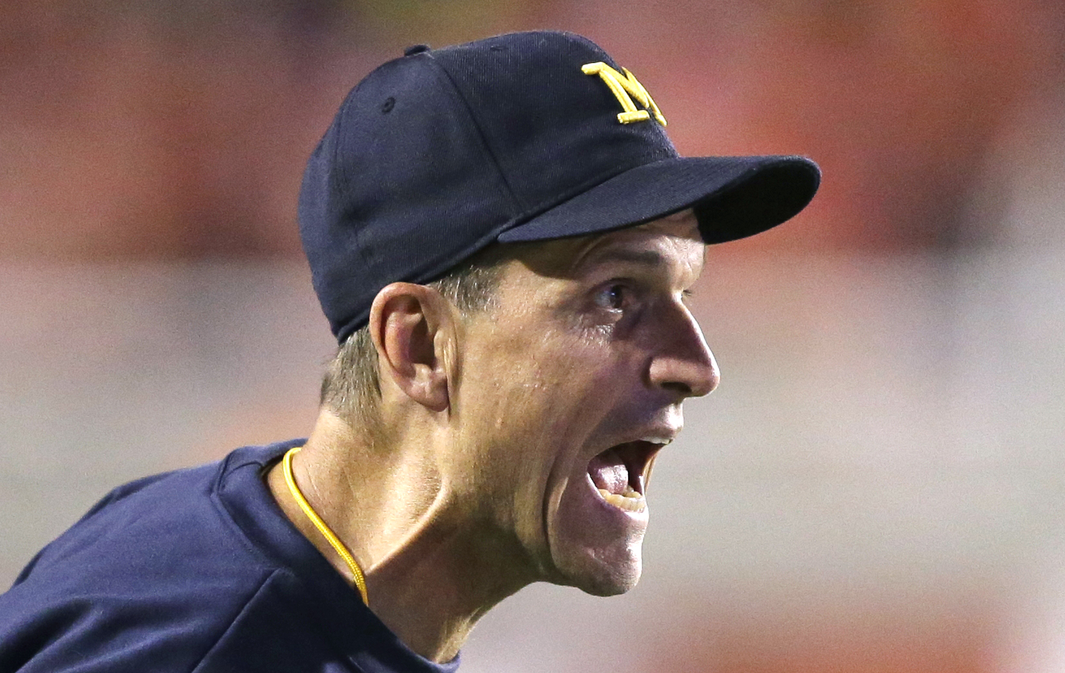 Michigan head coach Jim Harbaugh shouts to his team in the second half during an NCAA college football game against Utah, Thursday, Sept. 3, 2015, in Salt Lake City. Utah won 24-17. (AP Photo/Rick Bowmer)