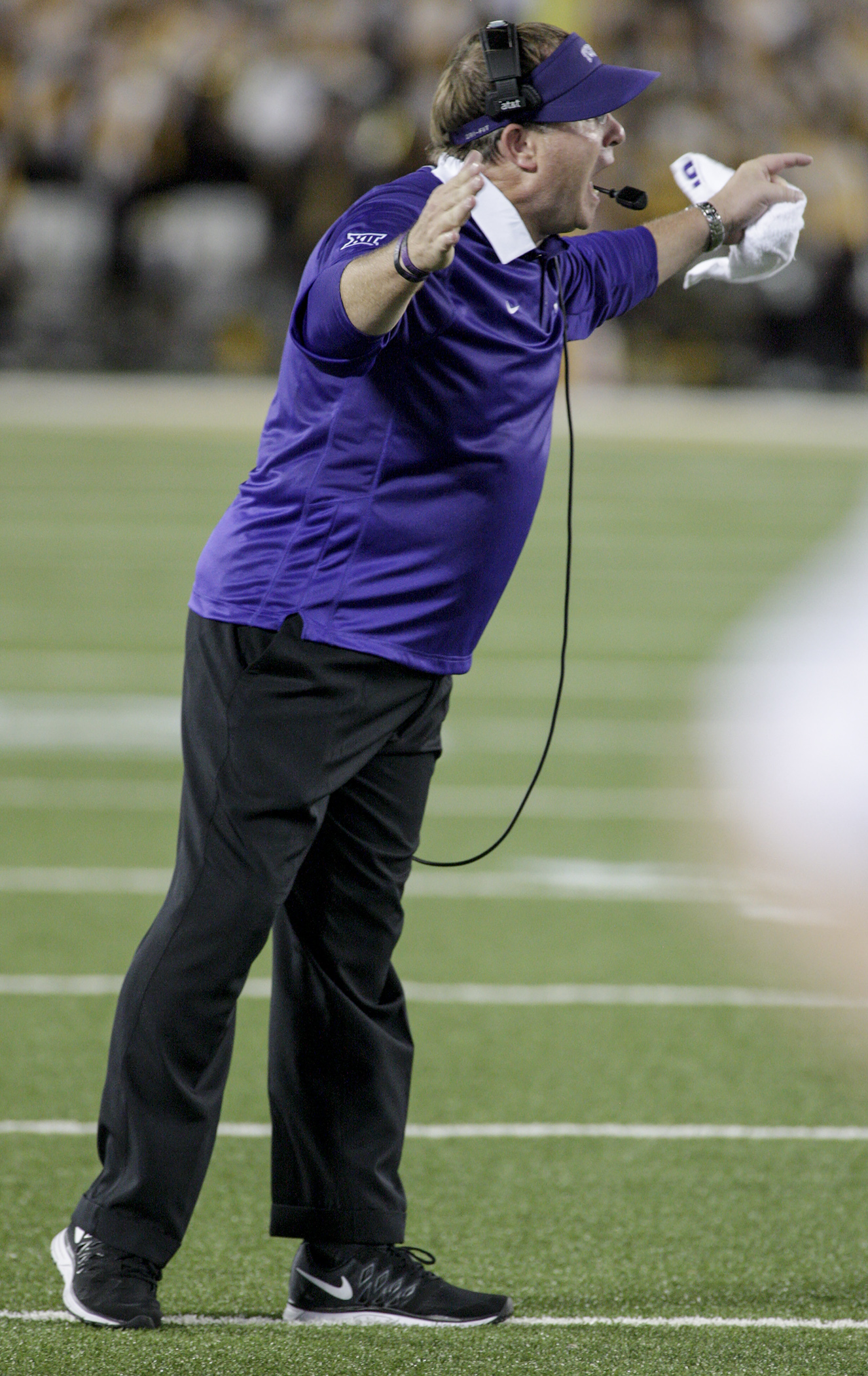 TCU head coach Gary Patterson yells to his team during the second half of an NCAA college football game against Minnesota on Thursday, Sept. 3, 2015, in Minneapolis. TCU won 23-17. (AP Photo/Paul Battaglia)
