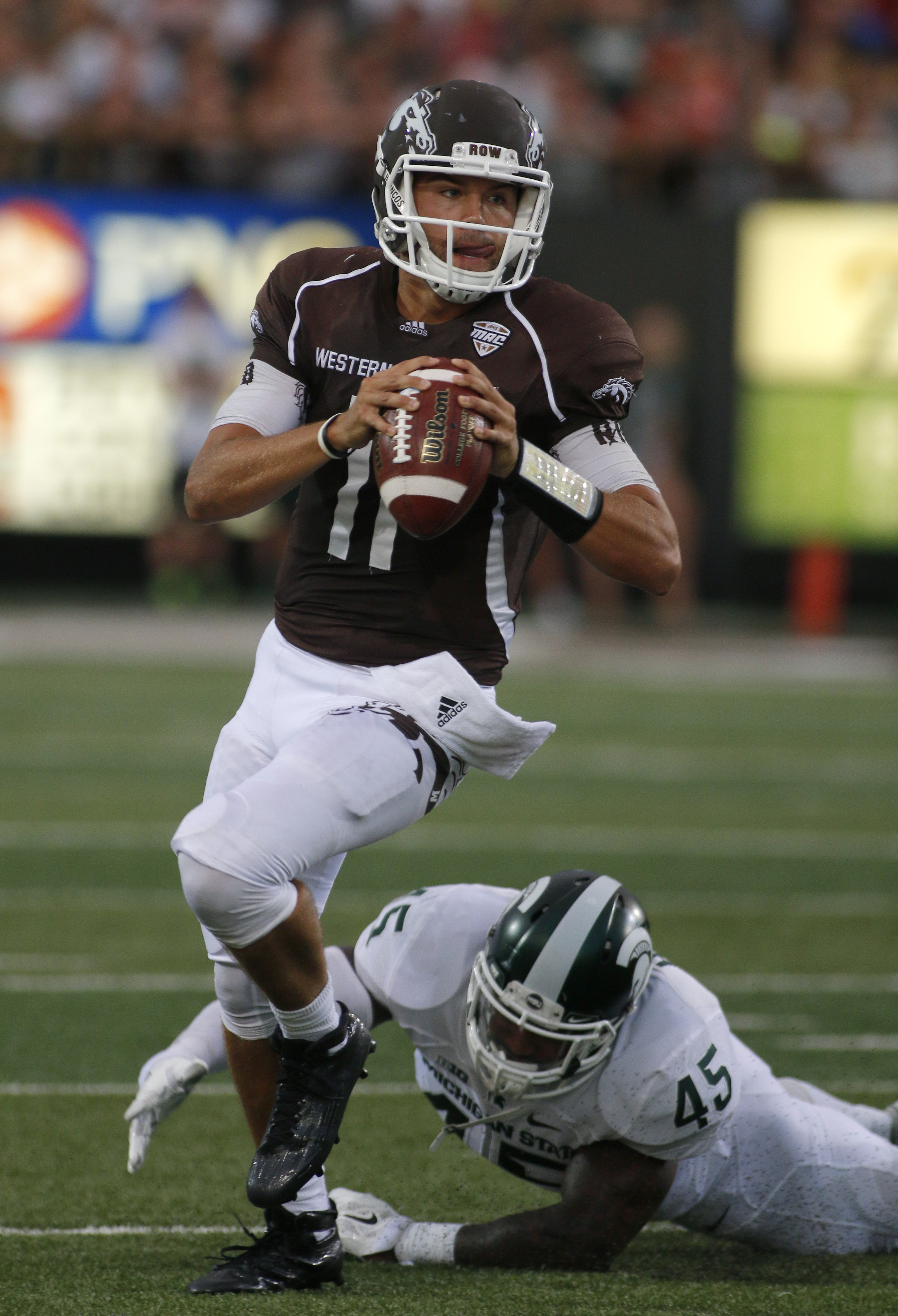 Western Michigan quarterback Zach Terrell escapes from a tackle attempt by Michigan State's Darien Harris (45) during the second quarter of an NCAA college football game, Friday, Sept. 4, 2015, in Kalamazoo, Mich. (AP Photo/Al Goldis)