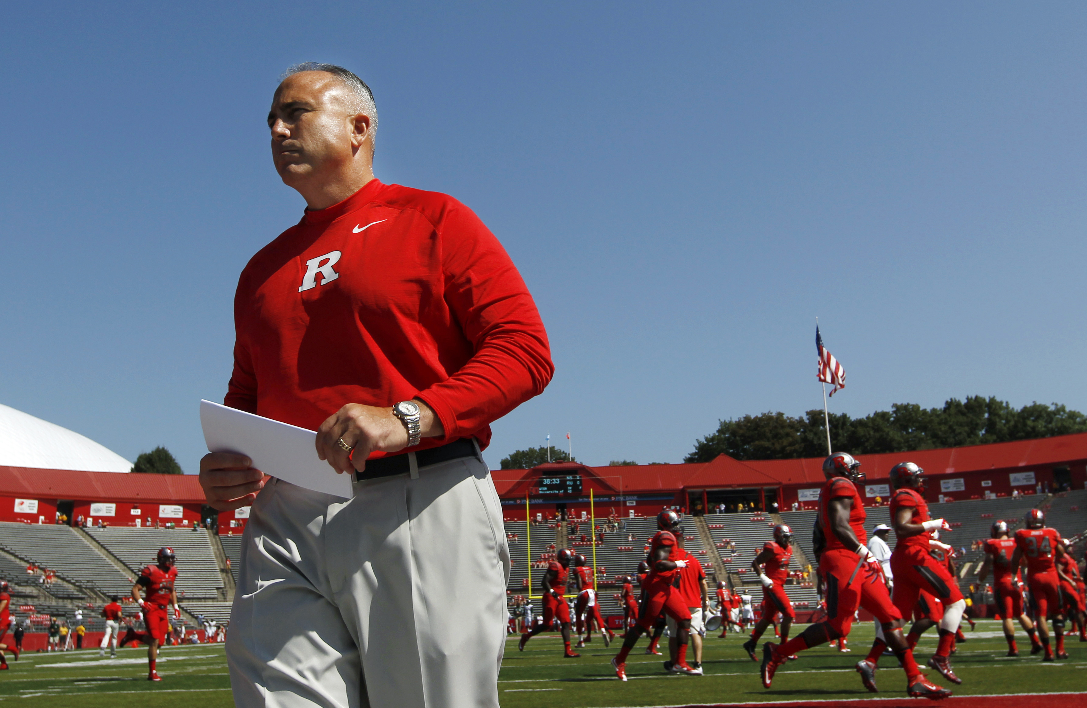 Rutgers head coach Kyle Flood walks on the field before an NCAA college football game against Norfolk State Saturday, Sept. 5, 2015, in Piscataway, N.J. (AP Photo/Mel Evans)