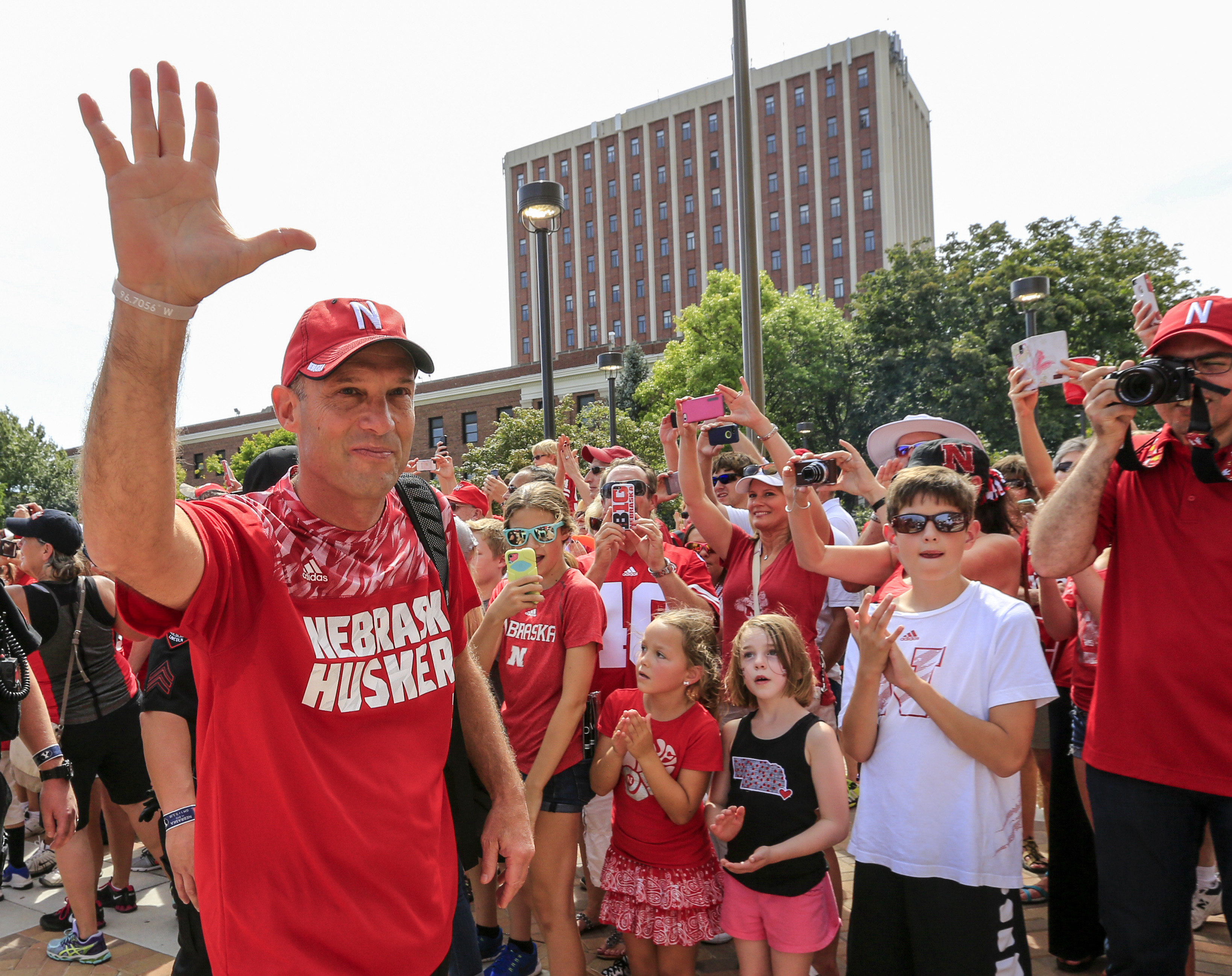 Nebraska head coach Mike Riley waves to fans as he arrives to Memorial Stadium before an NCAA college football game between Nebraska and Brigham Young in Lincoln, Neb., Saturday, Sept. 5, 2015. (AP Photo/Nati Harnik)