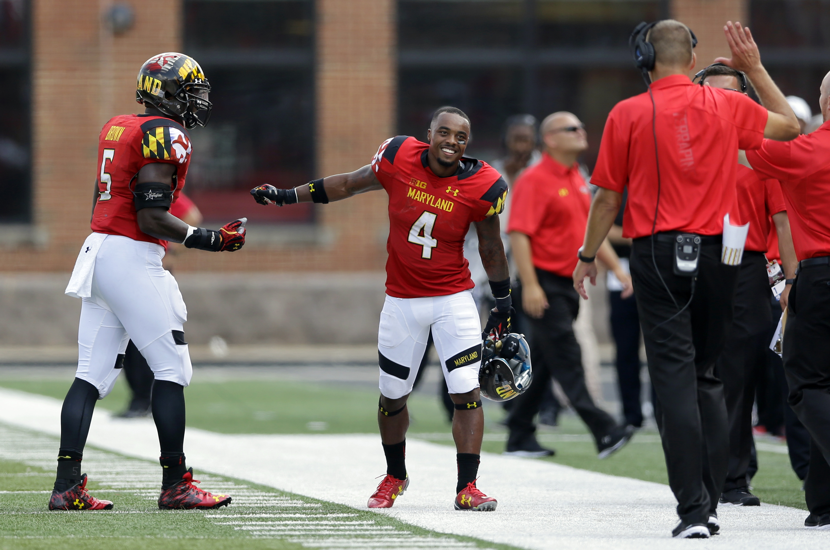 Maryland's William Likely (4) celebrates with teammate Wes Brown, left, and head coach Randy Edsall after officials overturned a call to grant him a touchdown in the second half of an NCAA college football game against Richmond, Saturday, Sept. 5, 2015, i