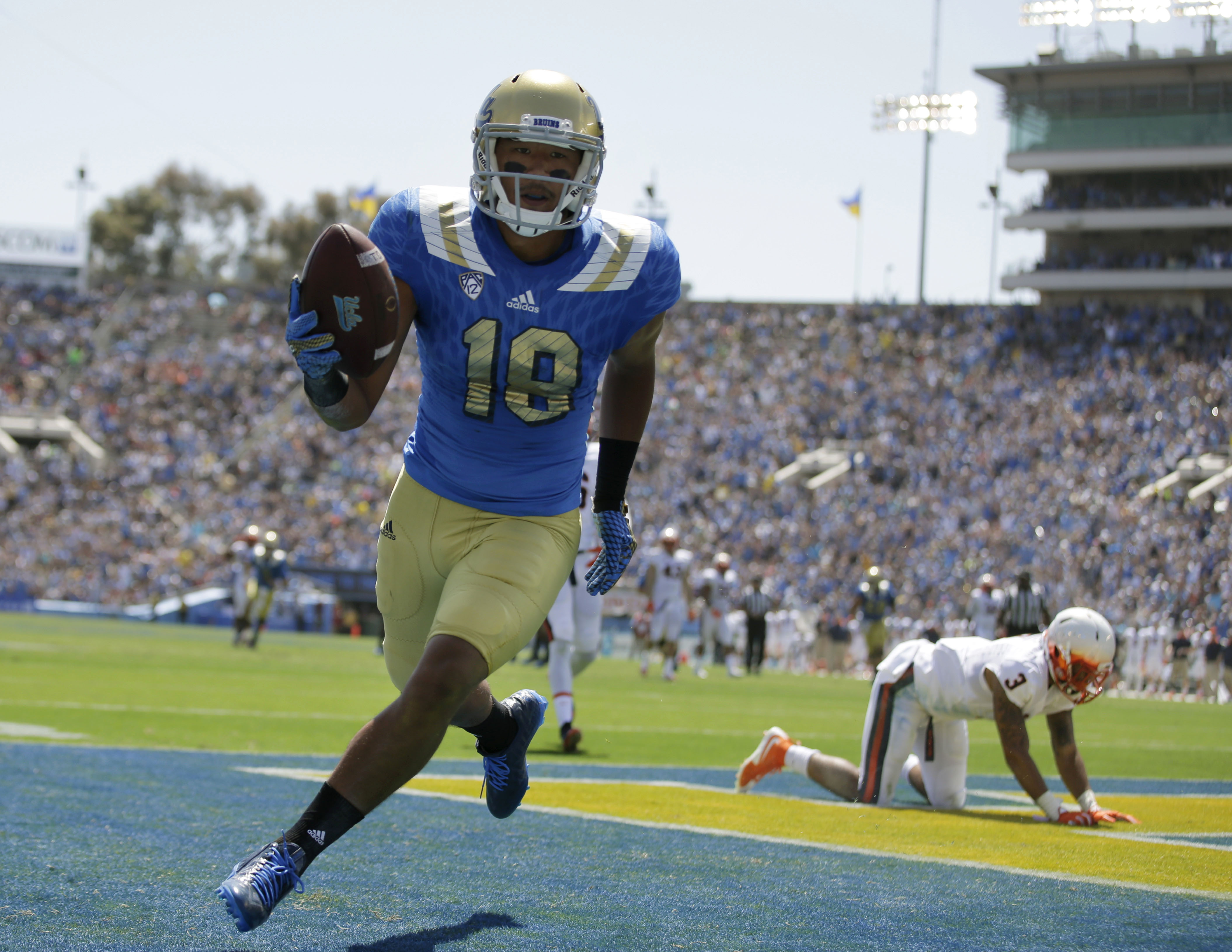 UCLA wide receiver Thomas Duarte scores a touchdown during the first half of an NCAA college football game against Virginia at the Rose Bowl, Saturday, Sept. 5, 2015, in Pasadena, Calif. (AP Photo/Jae C. Hong)