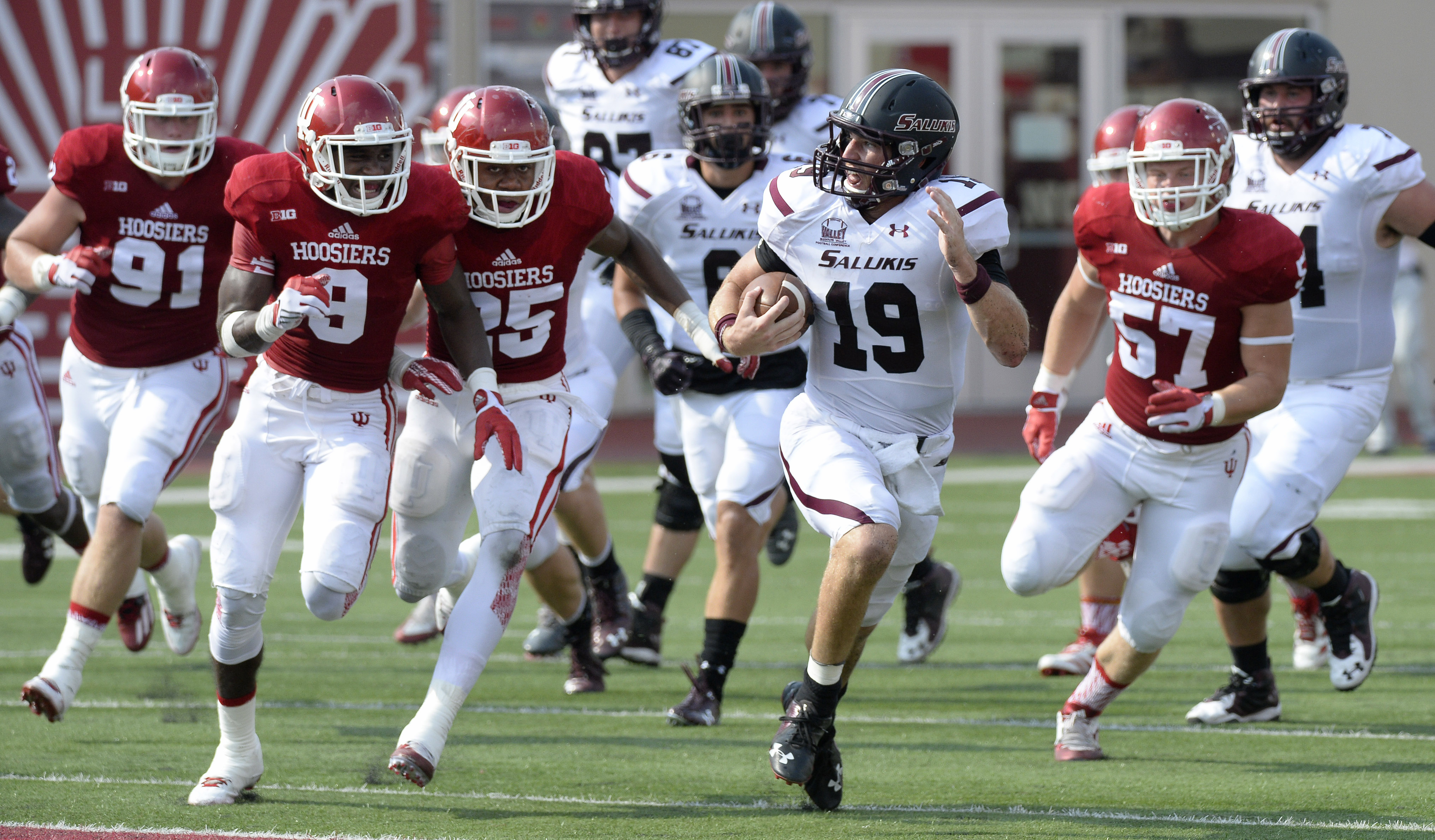 Southern Illinois quarterback Mark Iannotti (19) gets through the line during an NCAA college football game against Indiana, Saturday, Sept. 5, 2015, in Bloomington, Ind. (Chris Howell/The Herald-Times via AP) MANDATORY CREDIT