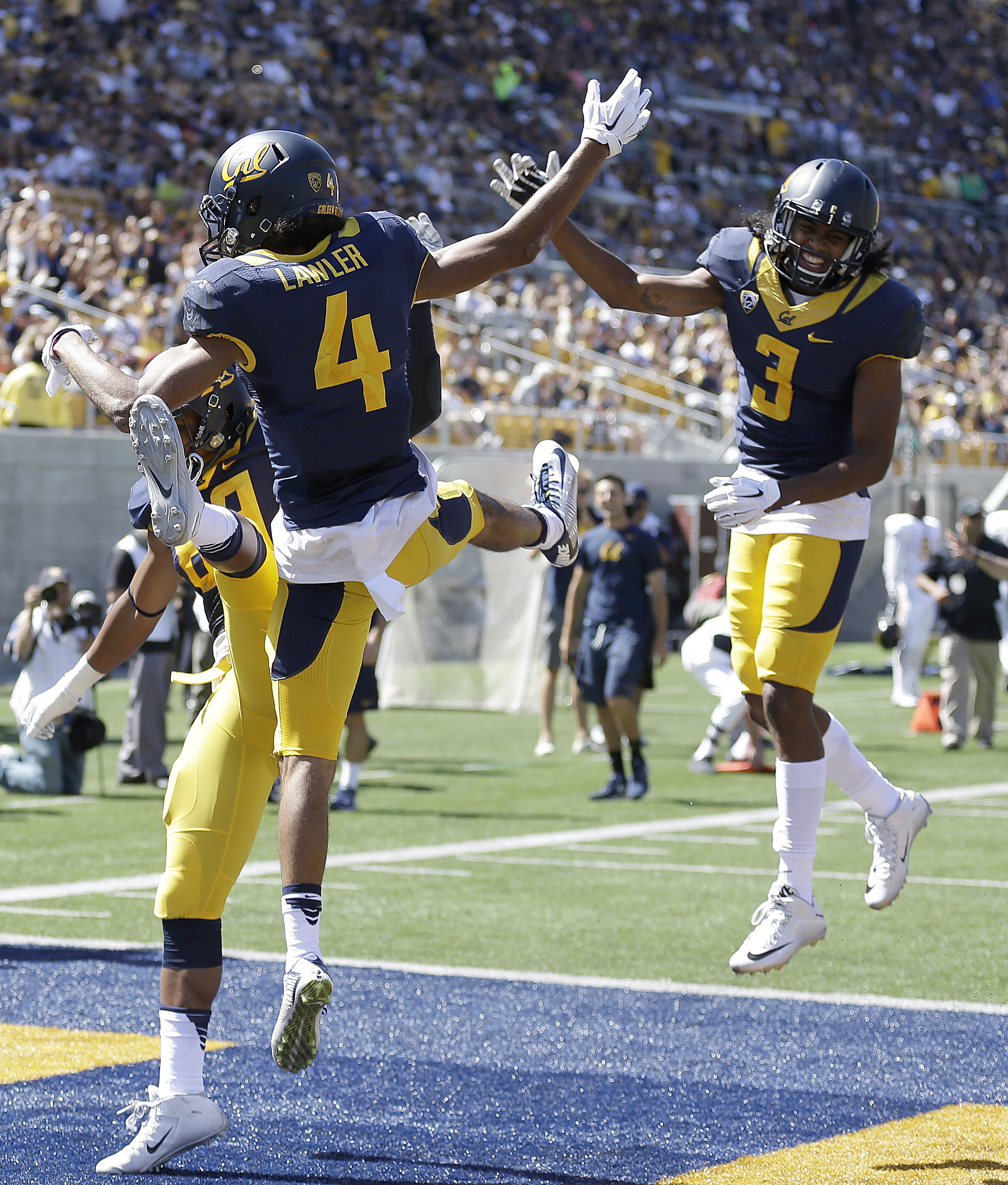 California's Kenny Lawler (4) celebrates with Maurice Harris (3) after scoring against Grambling State during the first half of an NCAA college football game Saturday, Sept. 5, 2015, in Berkeley, Calif. (AP Photo/Ben Margot)