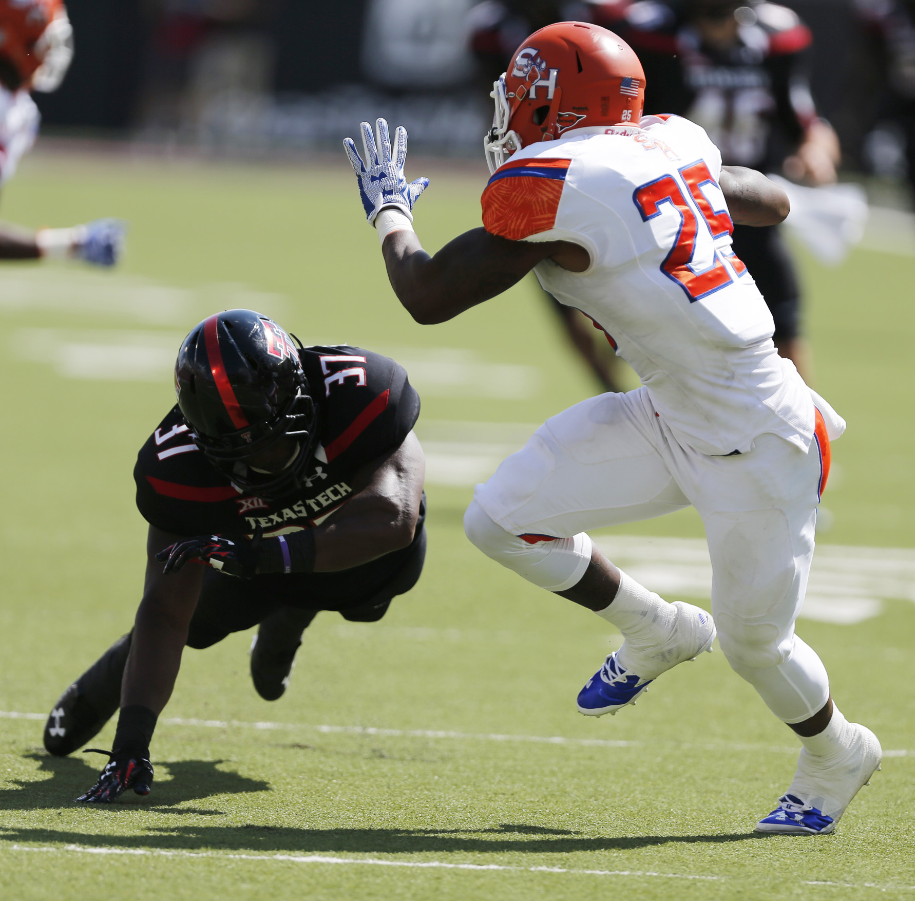 Sam Houston State's Gerald Thomas (25) carries the ball as Texas Tech's Bobby Esiaba defends during an NCAA college football game Saturday, Sept. 5, 2015, in Lubbock, Texas. (Mark Rogers/Lubbock Avalanche-Journal via AP) ALL LOCAL TELEVISION OUT; MANDATOR