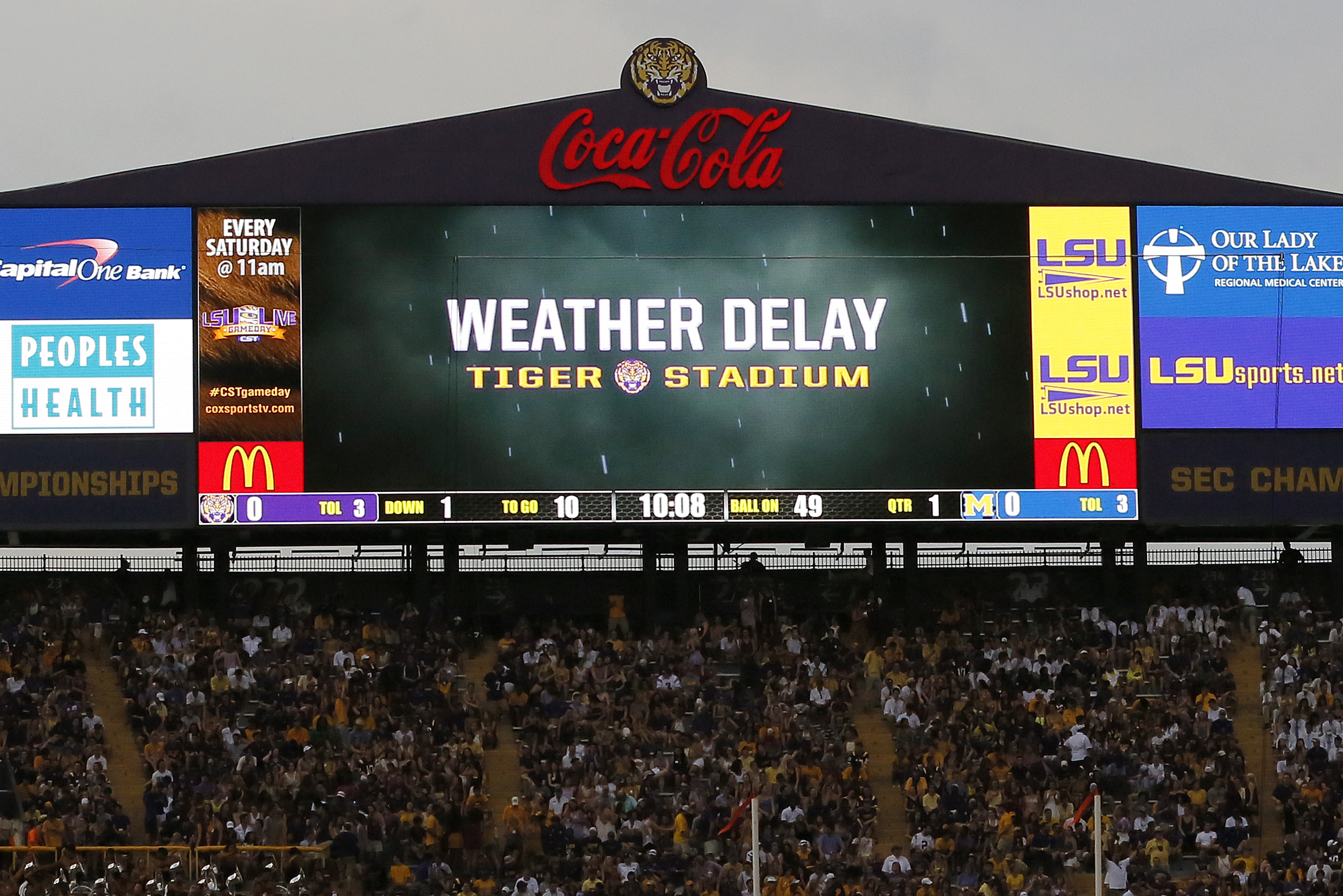 A weather delay is enforced due to lightning shortly after the beginning of the first quarter of an NCAA college football game between LSU and McNeese State in Baton Rouge, La., Saturday, Sept. 5, 2015. (AP Photo/Jonathan Bachman)