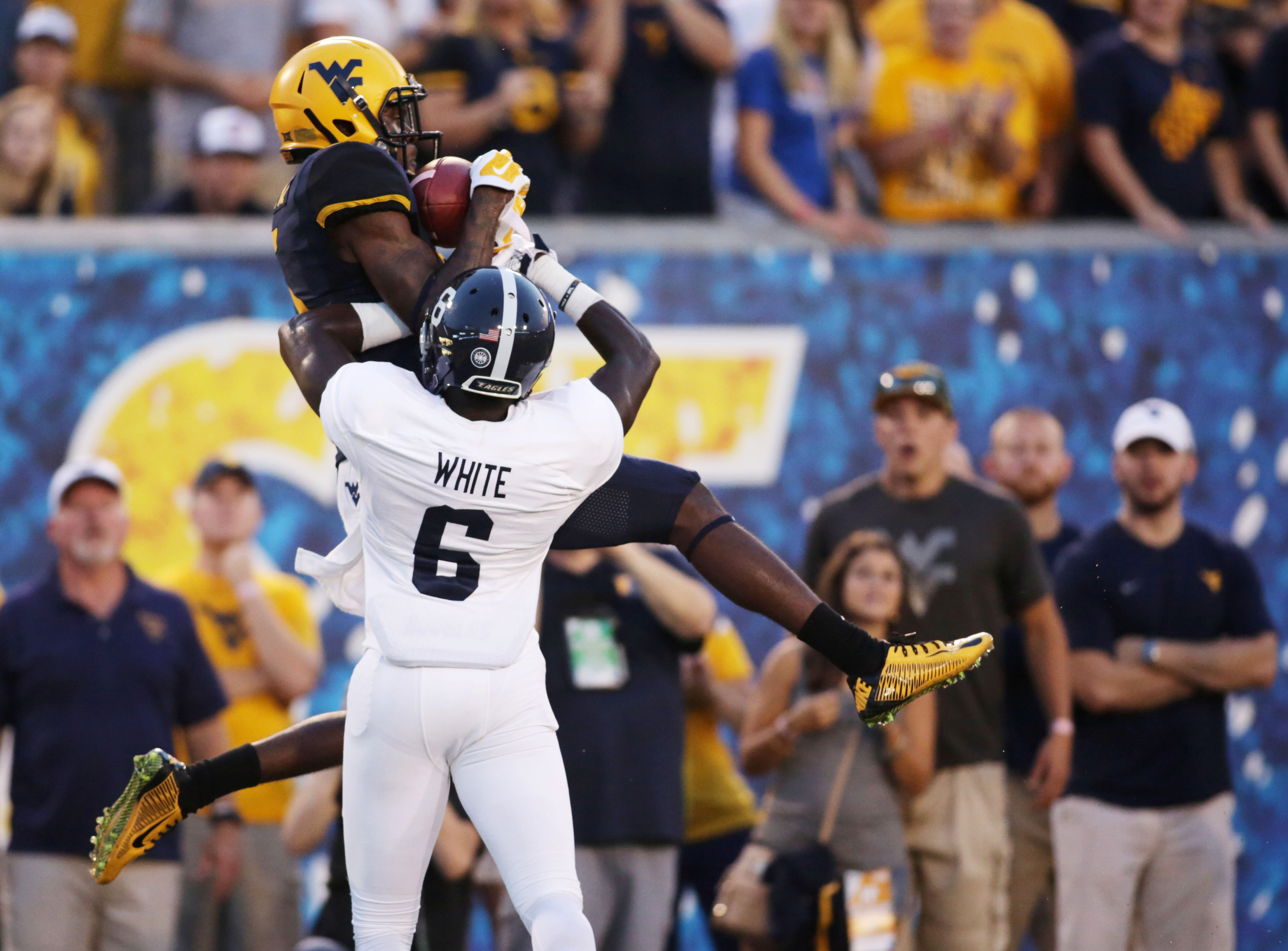 West Virginia wide receiver Jovon Durante, top, makes a catch for a touchdown while being defended by Georgia Southern cornerback Darrius White (6) in the first half of an NCAA college football game, Saturday, Sept. 5, 2015, in Morgantown, W.Va. (AP Photo