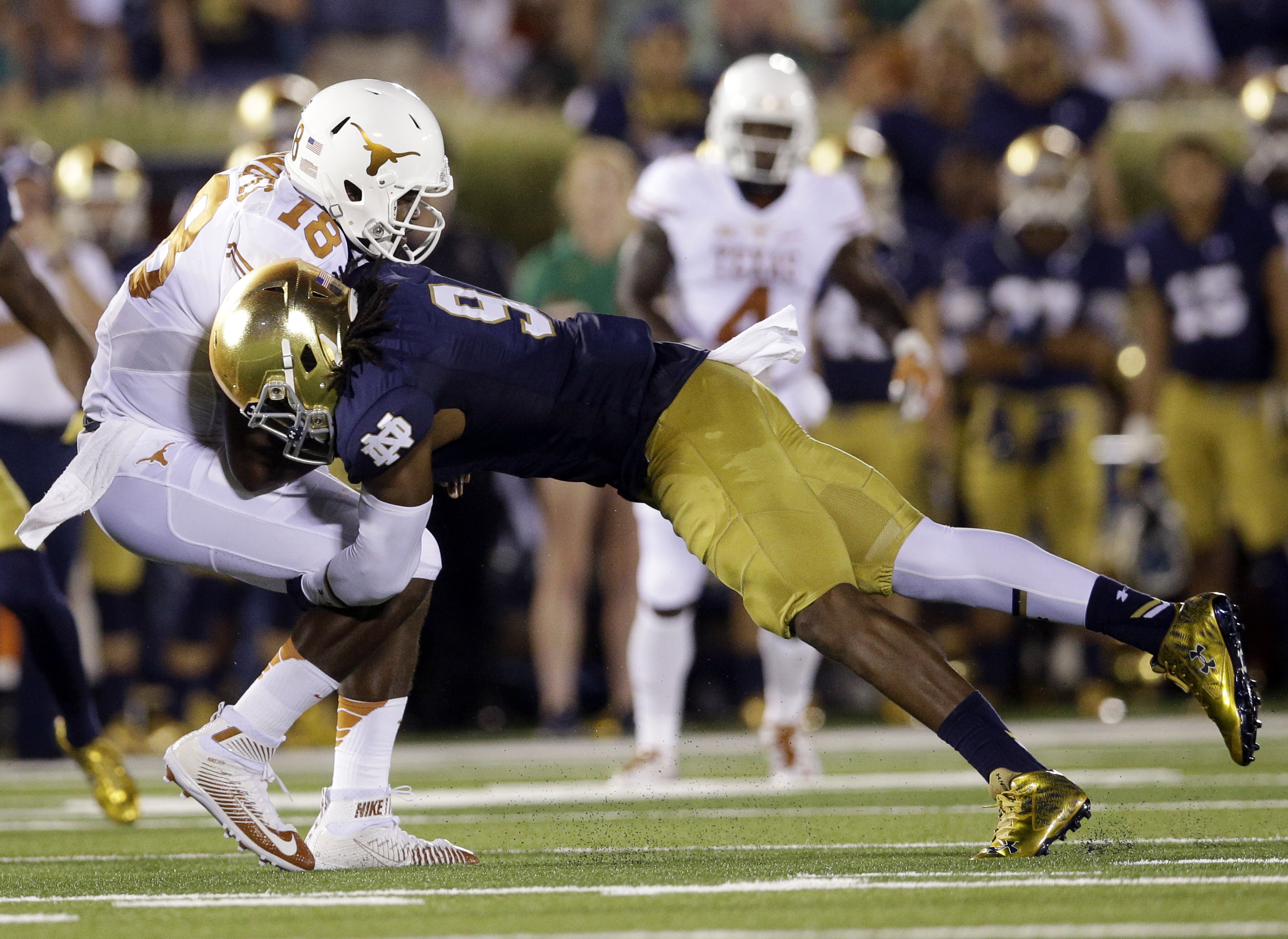 Notre Dame linebacker Jaylon Smith, right, tackles Texas quarterback Tyrone Swoopes during the first half of an NCAA college football game Saturday, Sept. 5, 2015, in South Bend, Ind. (AP Photo/Nam Y. Huh)