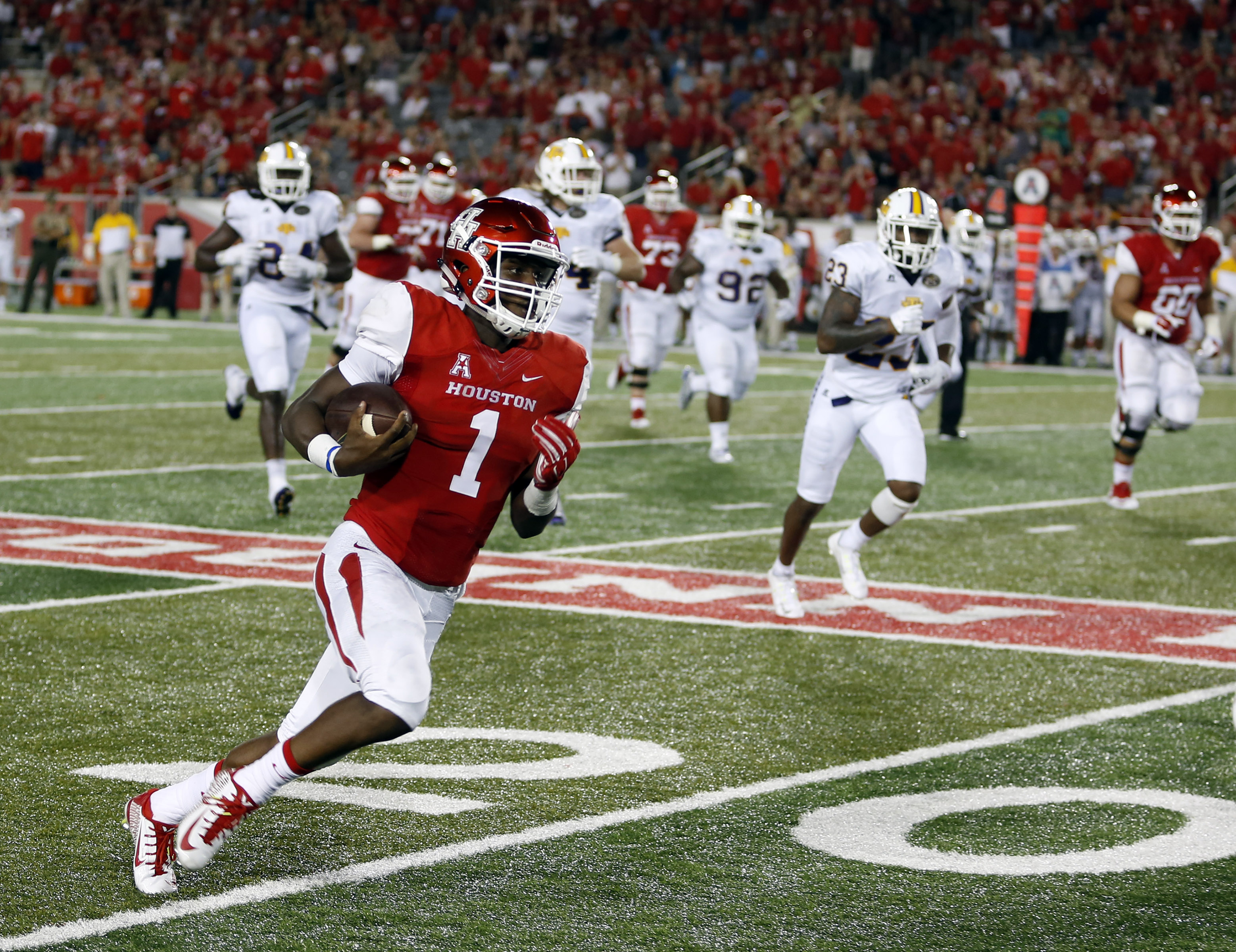 Houston's Greg Ward Jr. heads for a touchdown against Tennessee Tech during an NCAA college football game Saturday, Sept. 5, 2015, in Houston. (Craig Hartley/Houston Chronicle via AP)