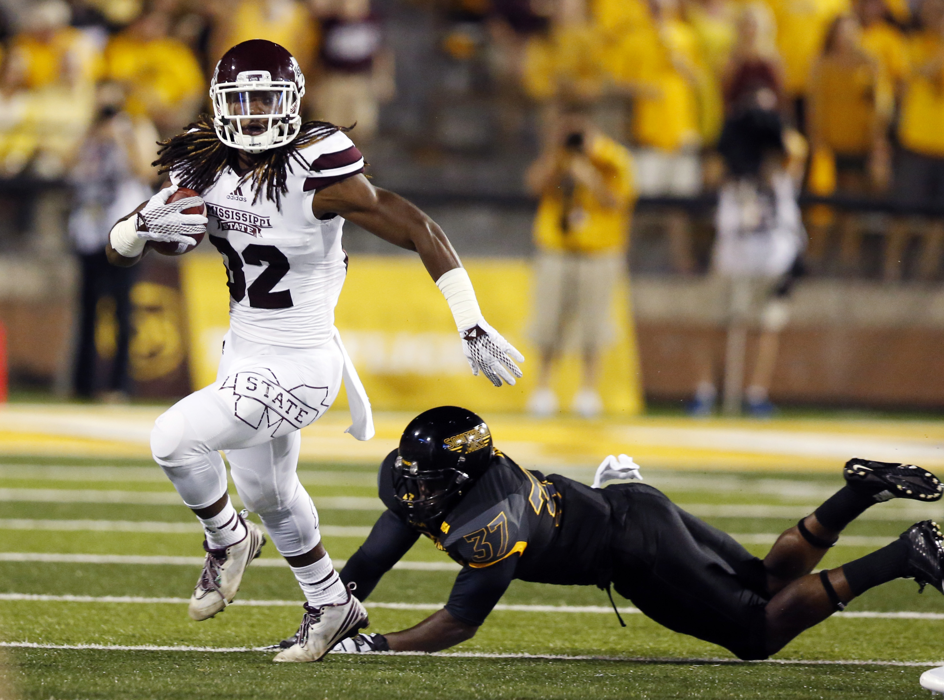 Mississippi State running back Ashton Shumpert (32) runs past an attempted tackle by Southern Mississippi linebacker Sherrod Ruff (37) during an NCAA college football game in Hattiesburg Miss., Saturday, Sept. 5, 2015. (AP Photo/Rogelio V. Solis)