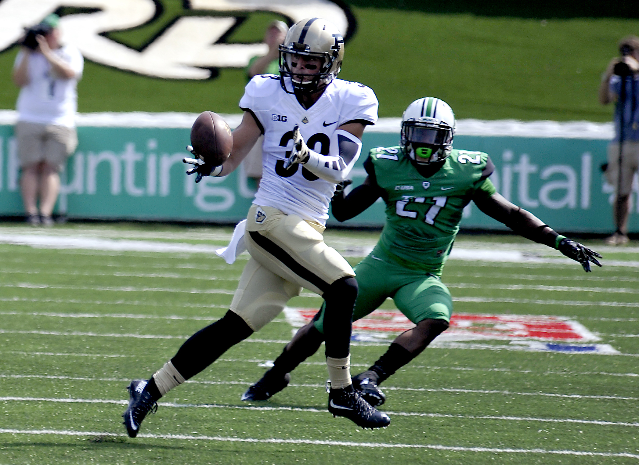 Purdue's Danny Anthrop (33) receives a pass with Marshall's Dejondre Coleman trying to defend the play during an NCAA football game in Huntington, W.Va., Sunday, Sept. 6, 2015. (AP Photo/Chris Tilley)