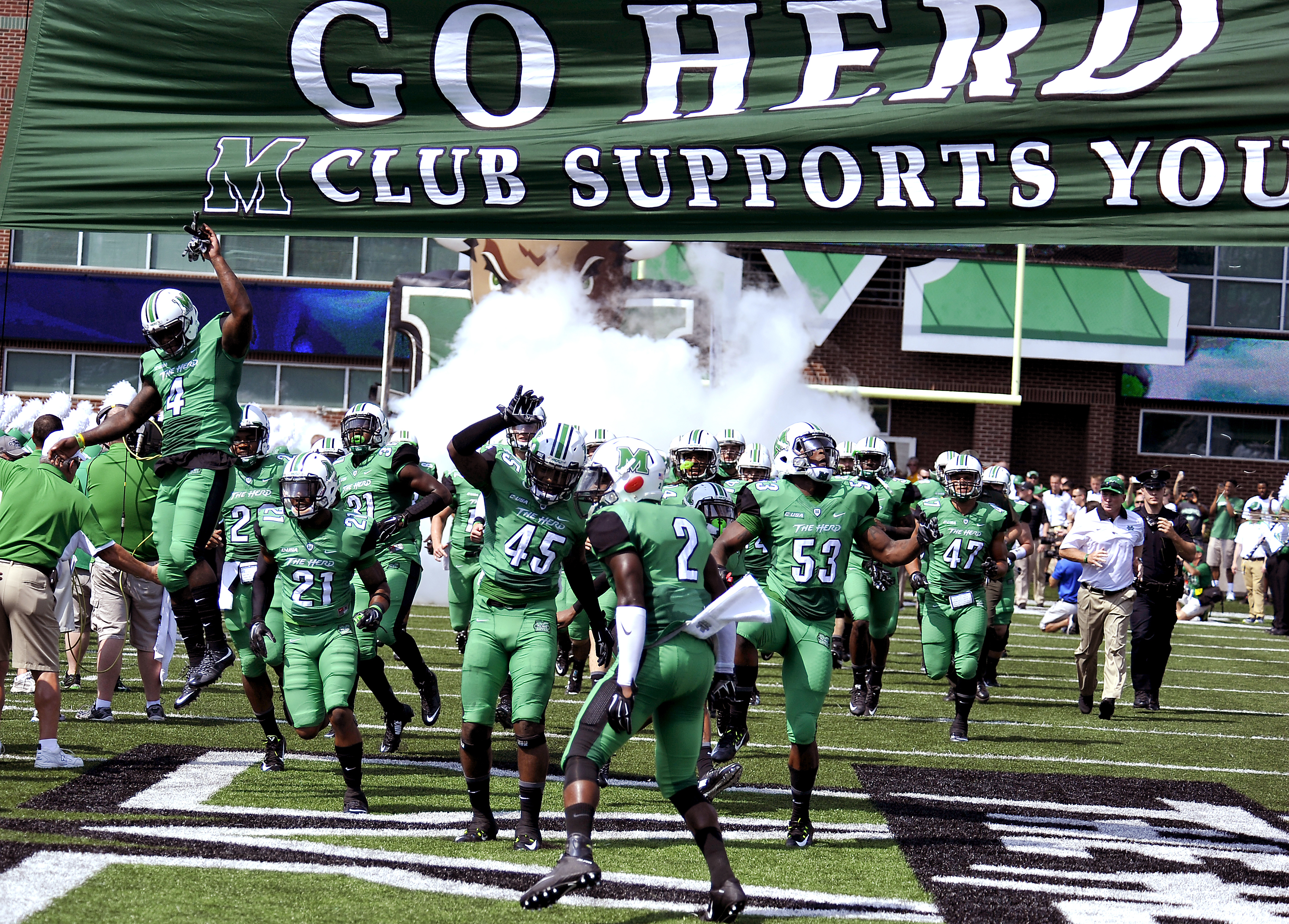 Marshall Thundering  Herd Football take the filed for the 2015- 2016 season opening game with against Purdue during an NCAA football game in Huntington, W.Va., Sunday, Sept. 6, 2015. (AP Photo/Chris Tilley)