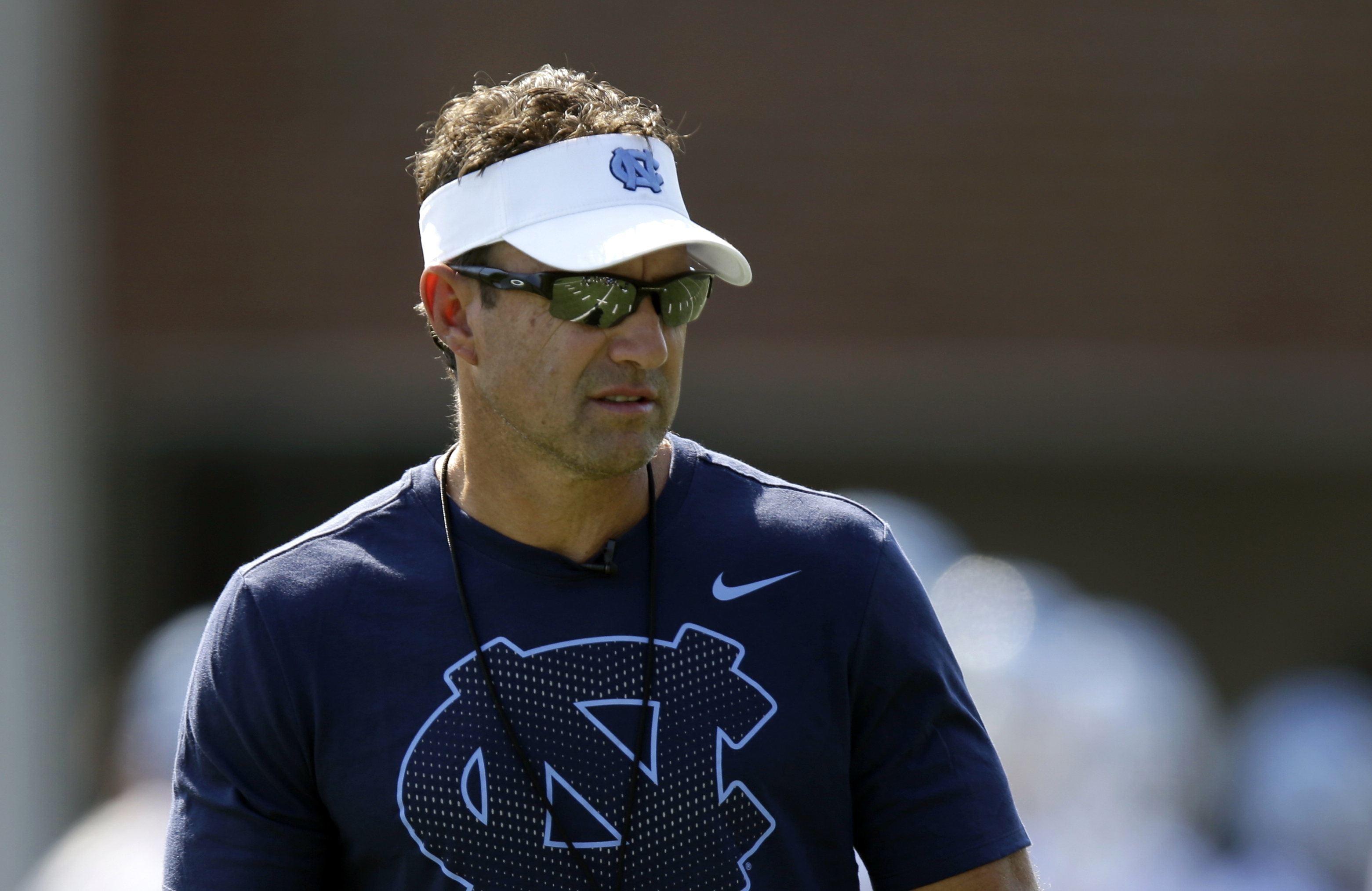 FILE - In this Aug. 3, 2015, file photo, North Carolina coach Larry Fedora watches during the team's first NCAA college football practice of the season in Chapel Hill, N.C. Fedora walked into his weekly news conference Monday, Sept. 7, 2015, knowing the q