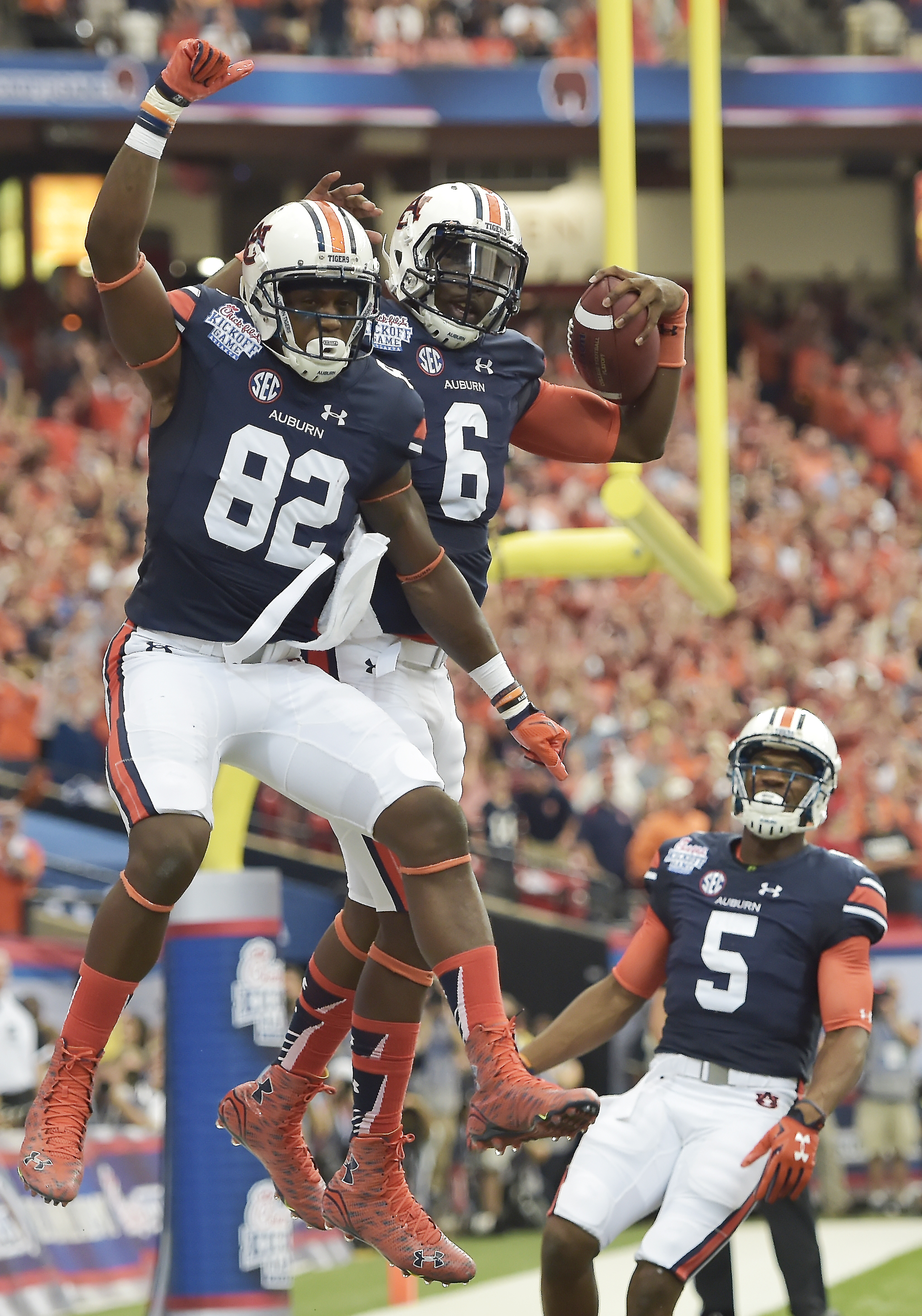 FILE - In this Sept. 5, 2015, file phtoo, Auburn quarterback Jeremy Johnson (6) celebrates his touchdown with Auburn wide receiver Melvin Ray (82) during the first half of an NCAA college football game against Louisville in Atlanta. (AP Photo/Mike Stewart