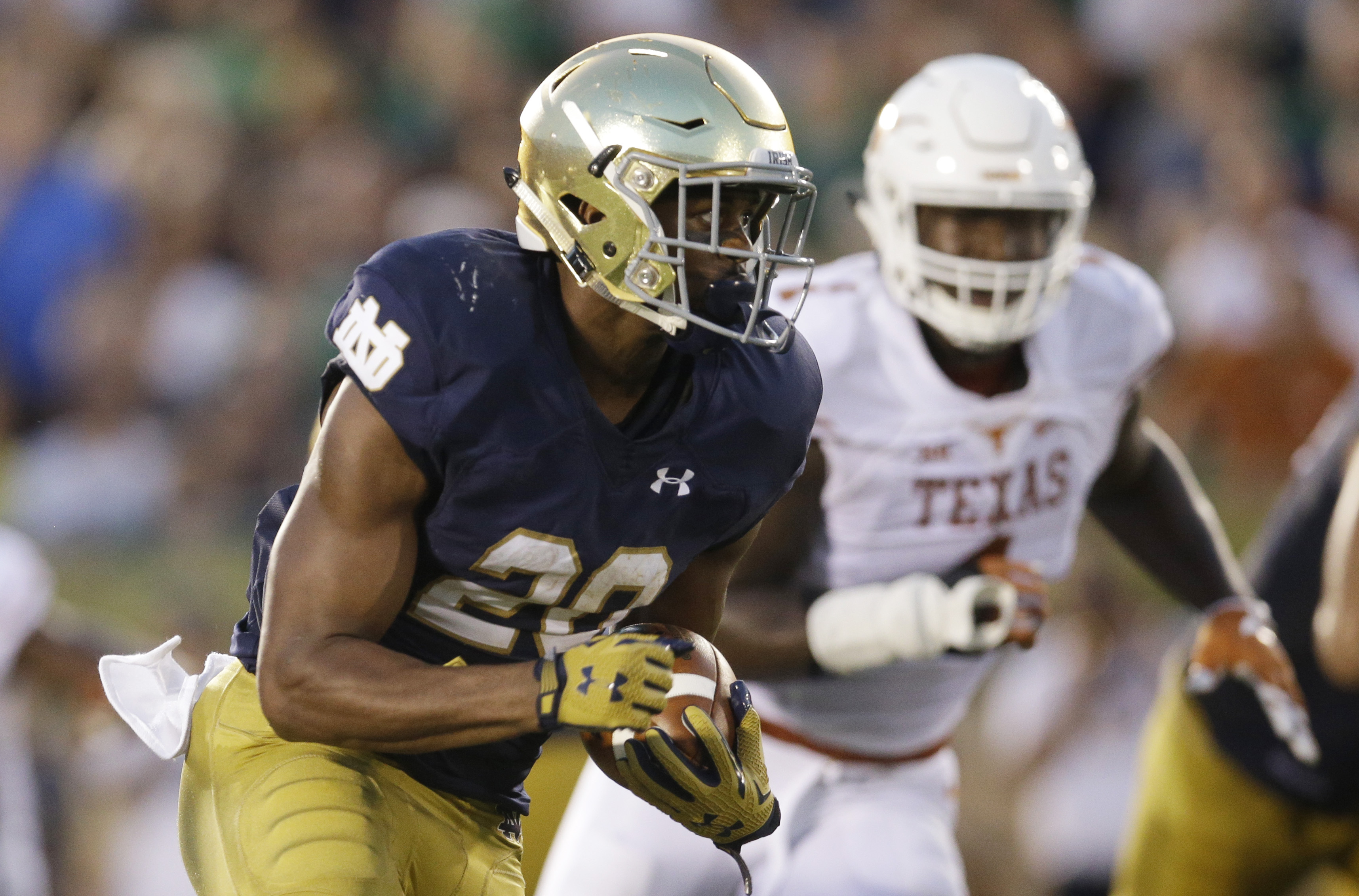 In this Sept. 5, 2015, photo, Notre Dame running back C.J. Prosise runs with the ball during the first half of an NCAA college football game against Texas in South Bend, Ind. .Prosise believes he could play linebacker for Notre Dame, if needed. For now, t